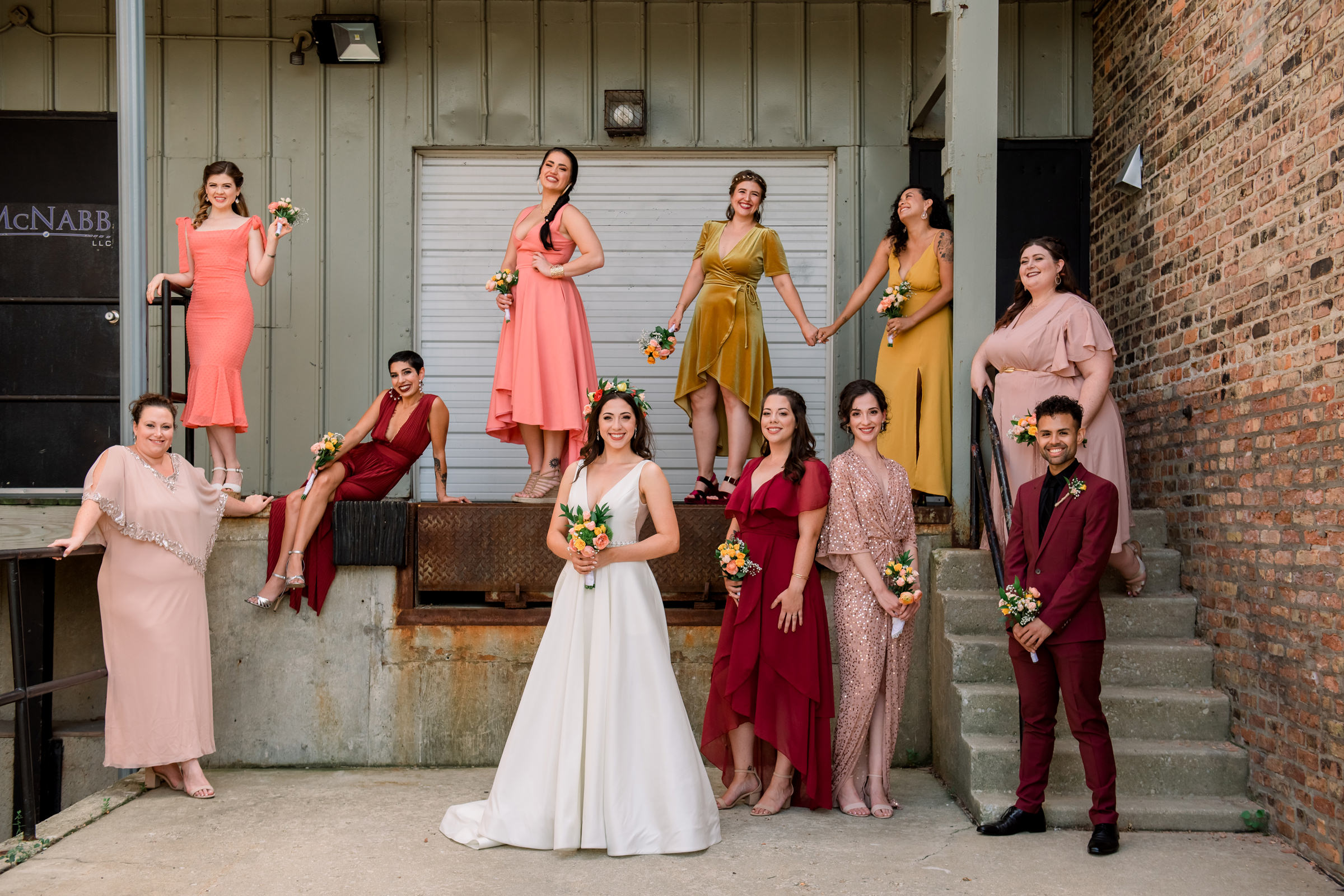 Group shot of bridal party in red, coral, photographed by Mike Zawadzki - New Jersey