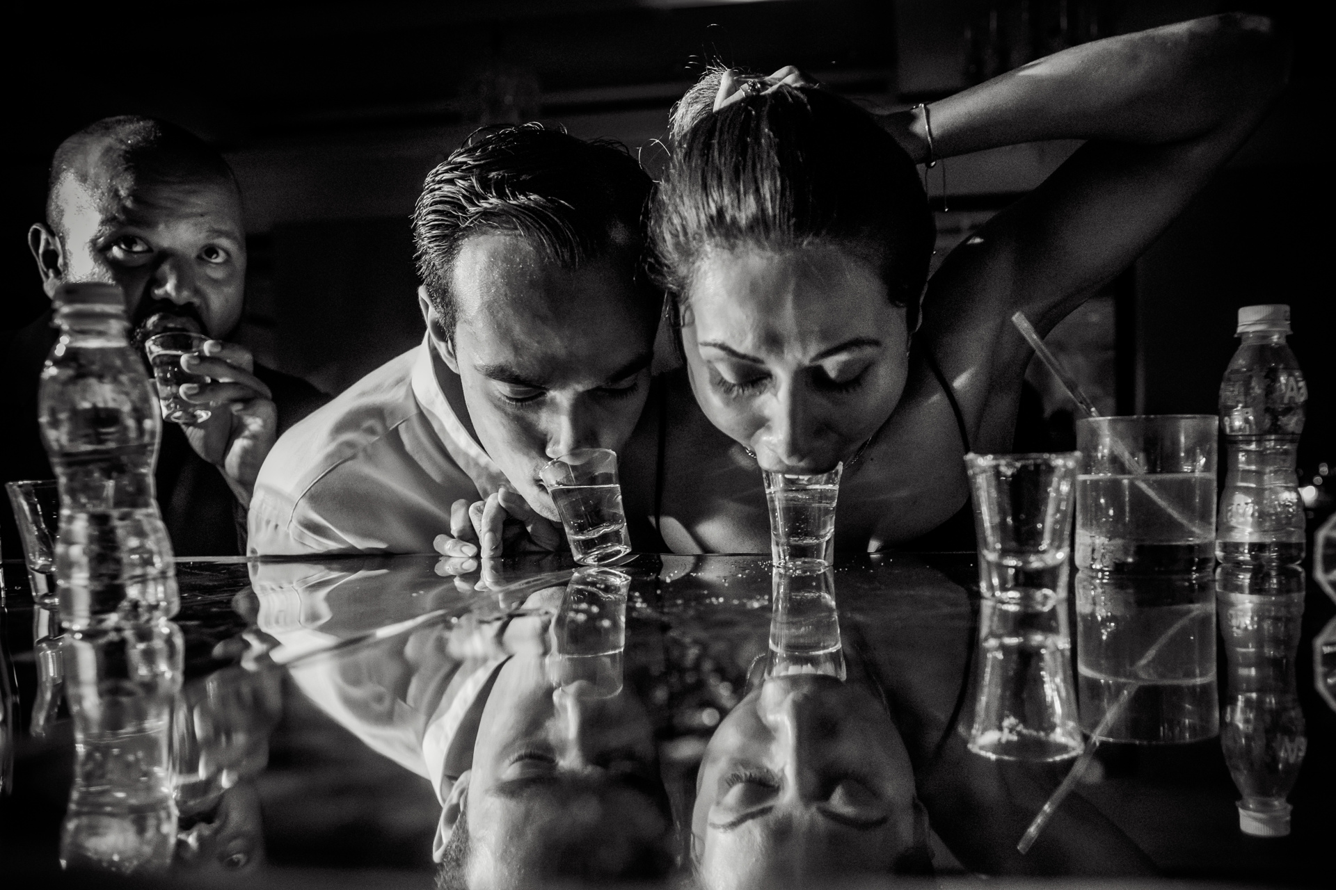Couple taking shots off the bar - photo by Sephi Bergerson