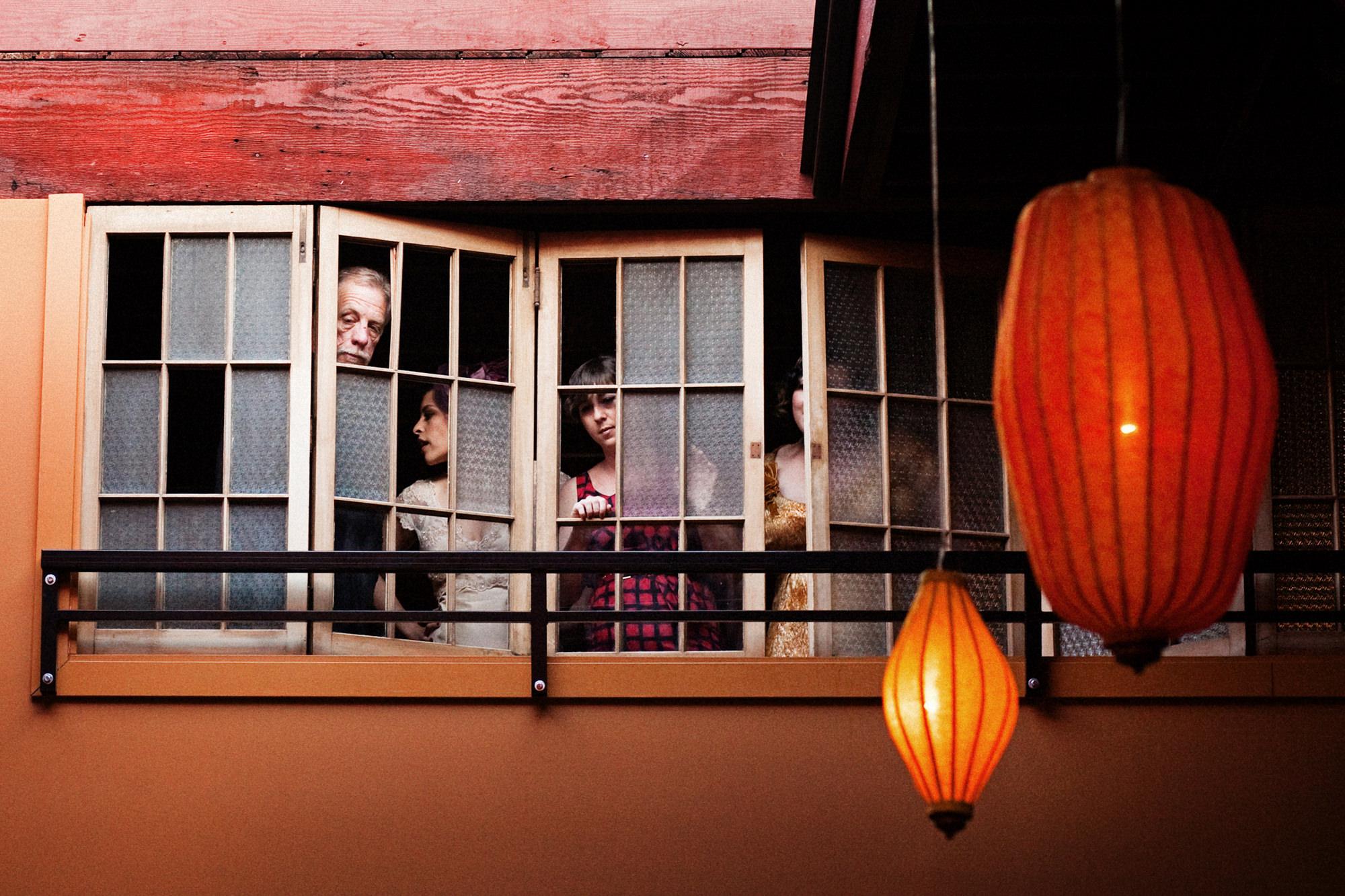 guests-await-the-wedding-through-window-worlds-best-wedding-photos-jenny-jimenez-seattle-wedding-photographers