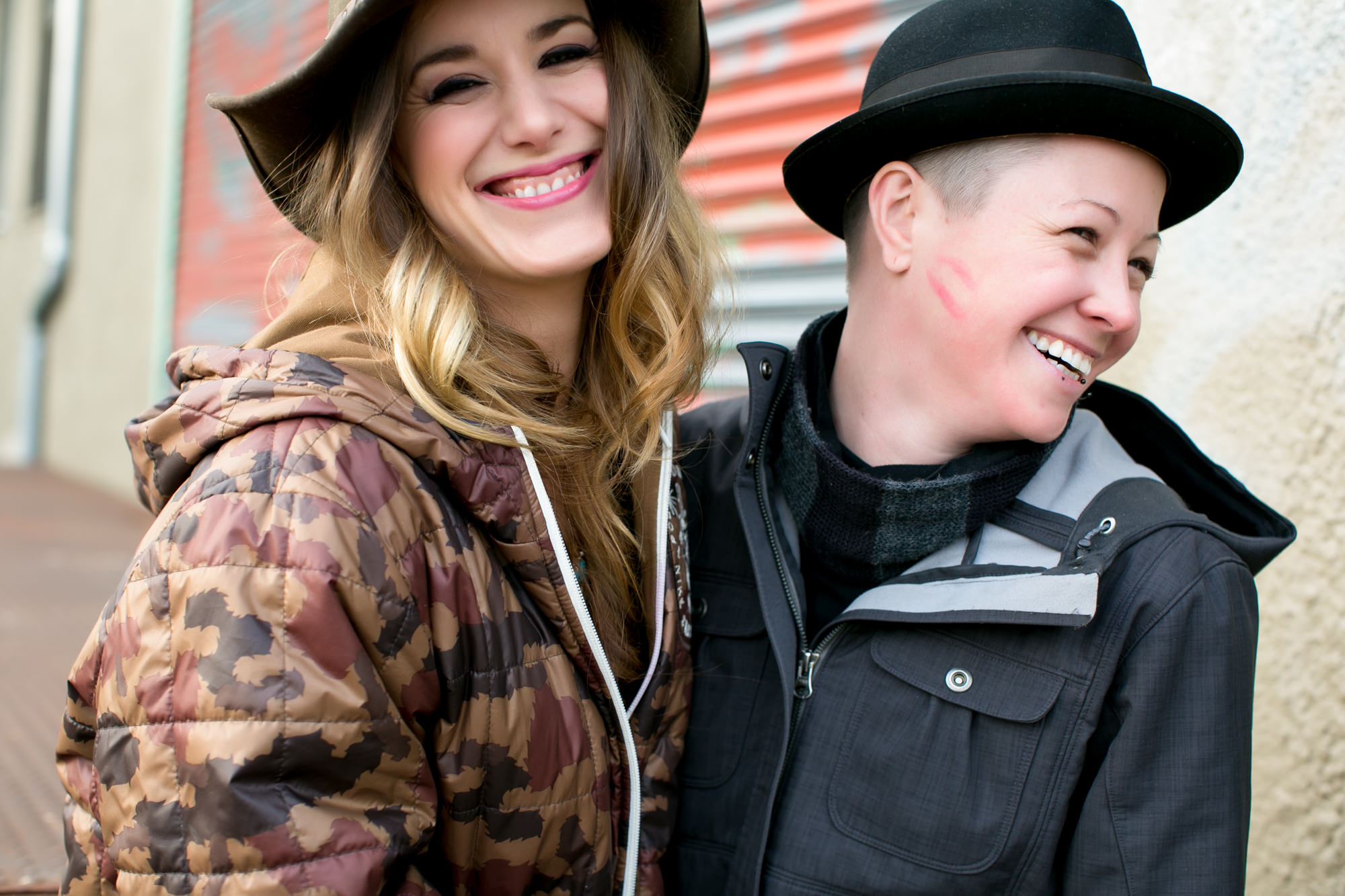 Happy portrait of two women with one who has a kiss print on her cheek - photo by Jessica Hill Photography