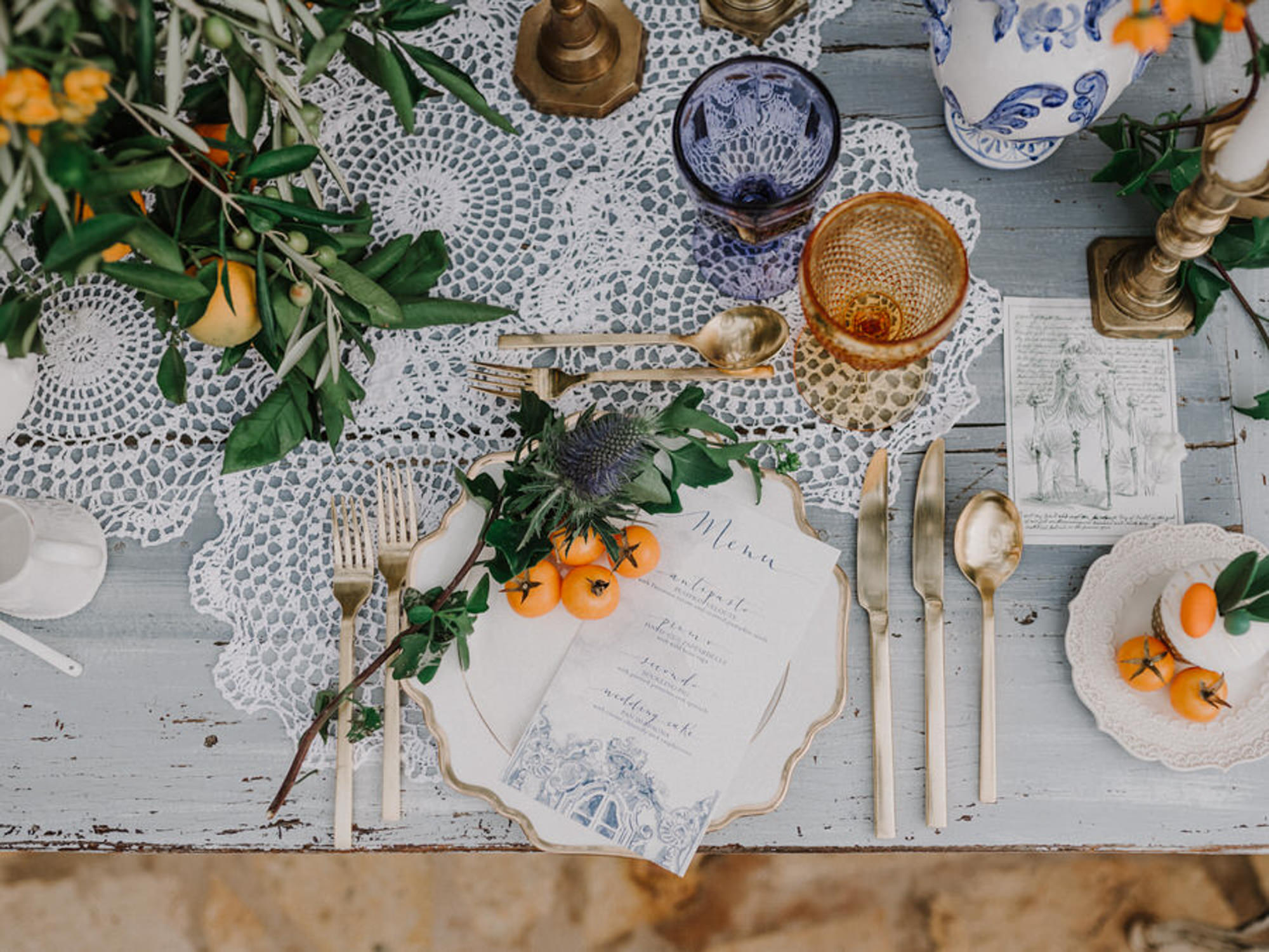 italian-place-setting-with-thistle-and-tangerines-worlds-best-wedding-photos-gianluca-adiovaso-italy-wedding-photographers