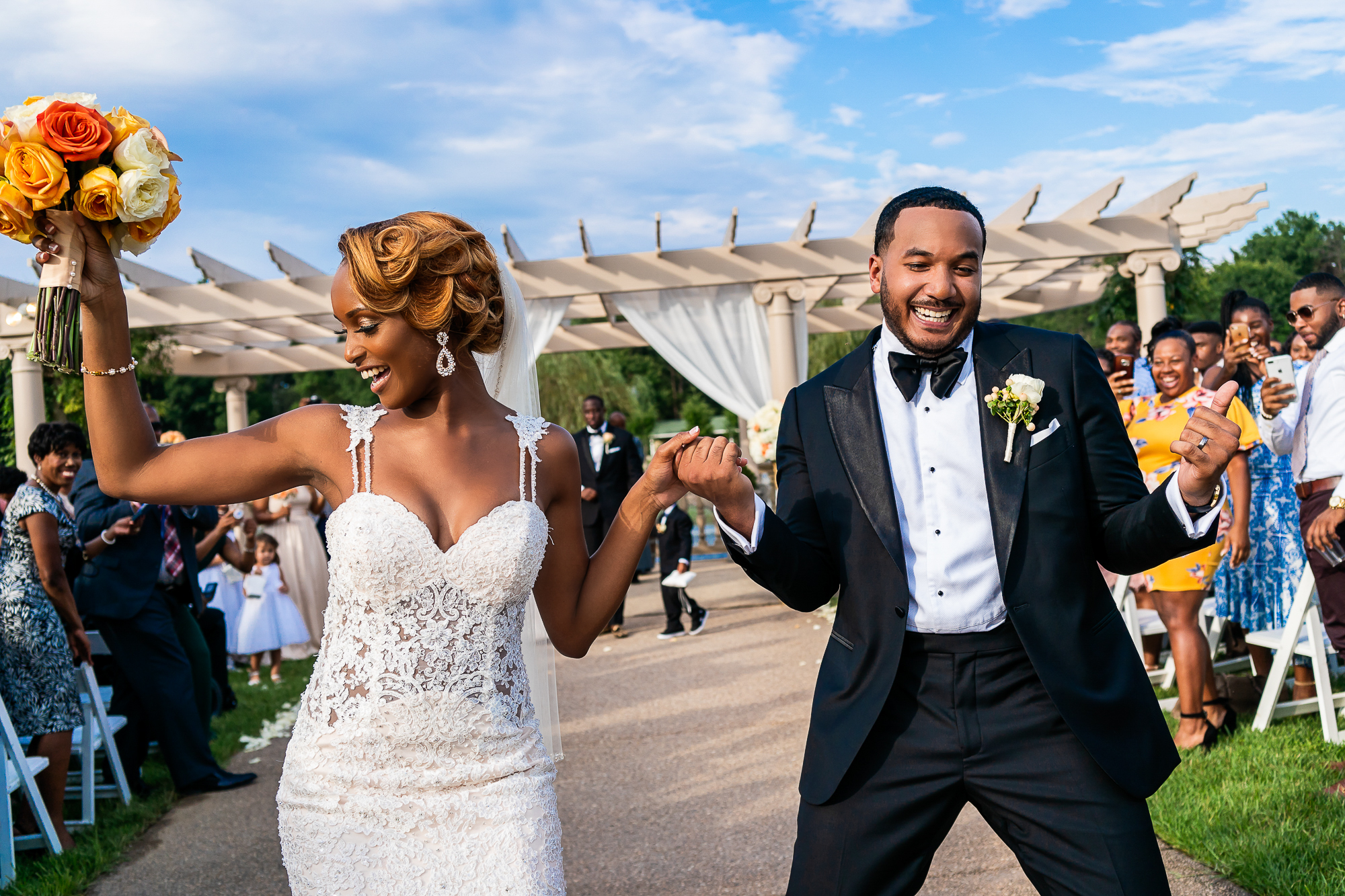 just-married-christopher-jason-studios-morais-vineyard-winery-bride-and-groom-celebrate-during-ceremony