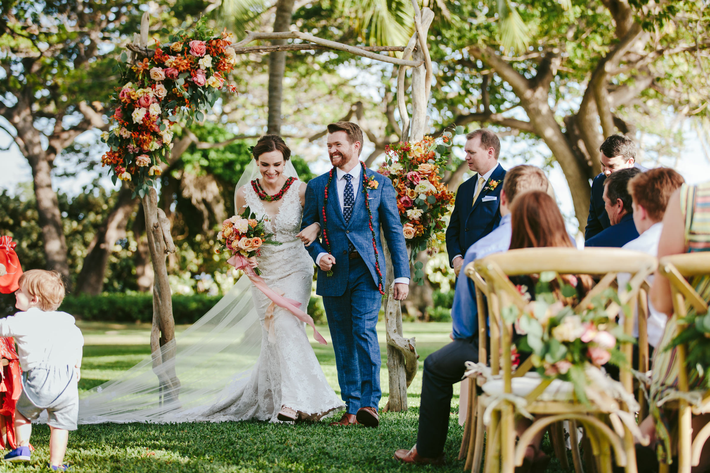 Just married couple at Olowalu Plantation House wedding photographed by Melia Lucida Photography