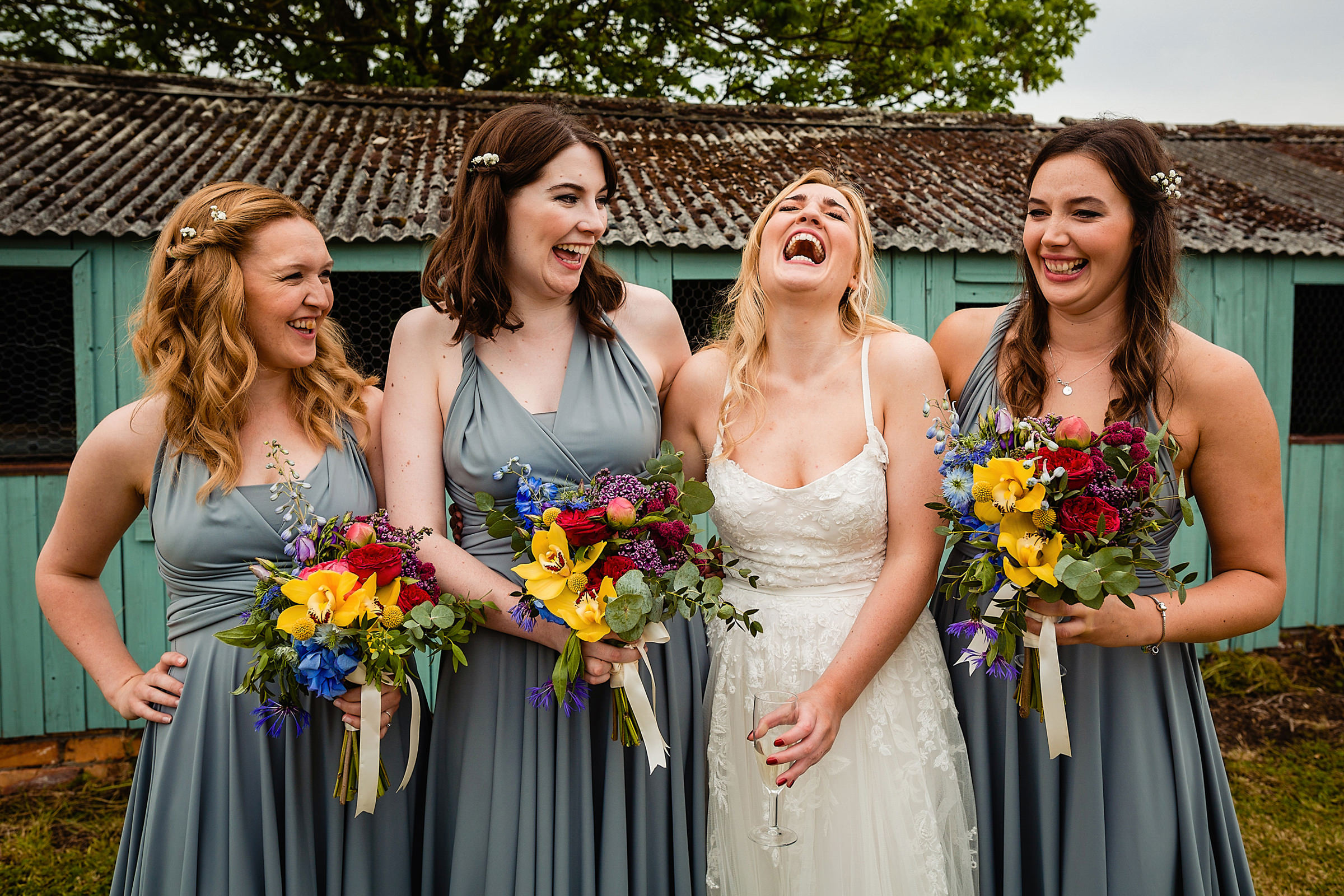 laughing-bride-and-bridesmaids-in-sage-wrap-dresses-emmaplusrich
