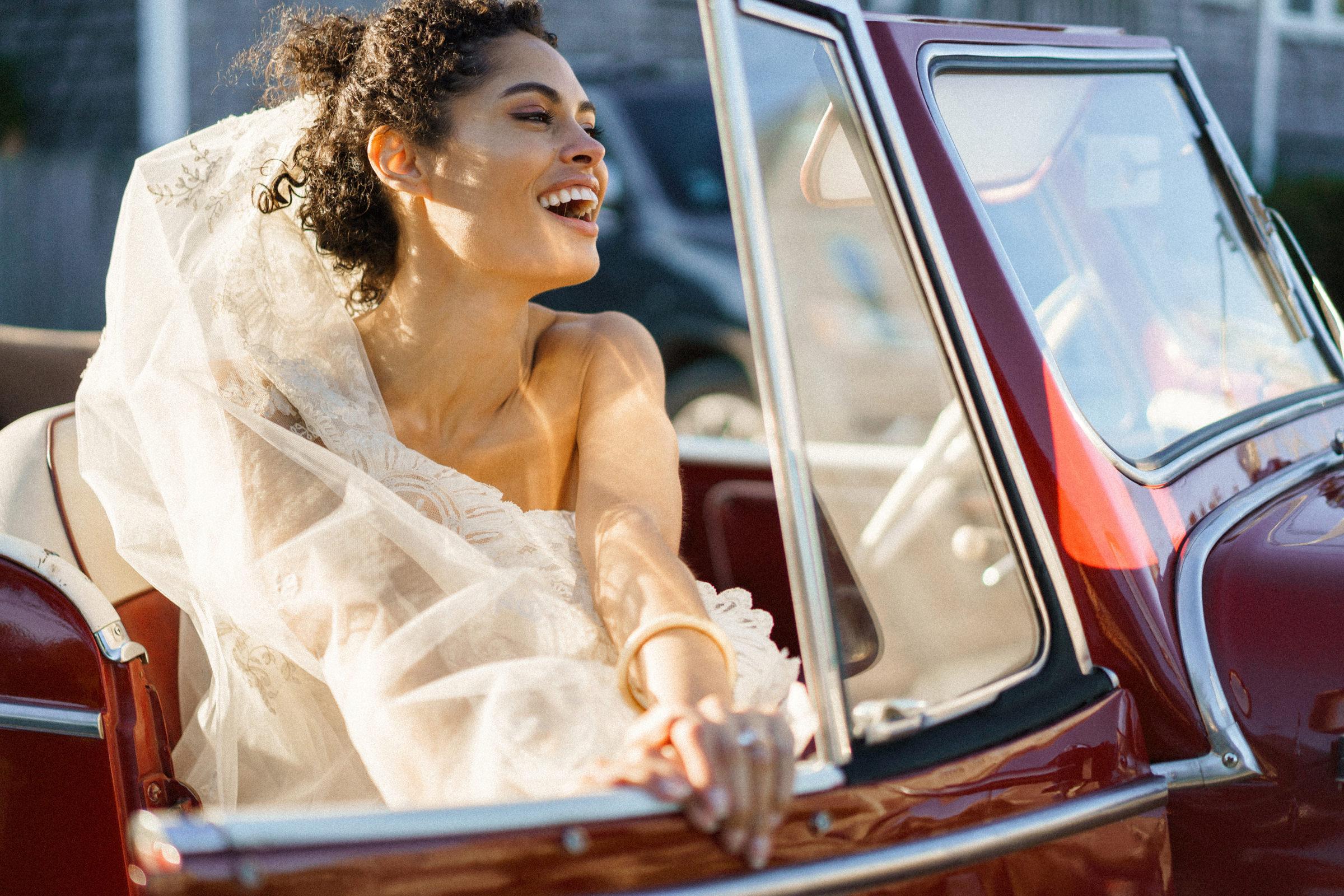 laughing-bride-exiting-convertible-alex-gordias-photography
