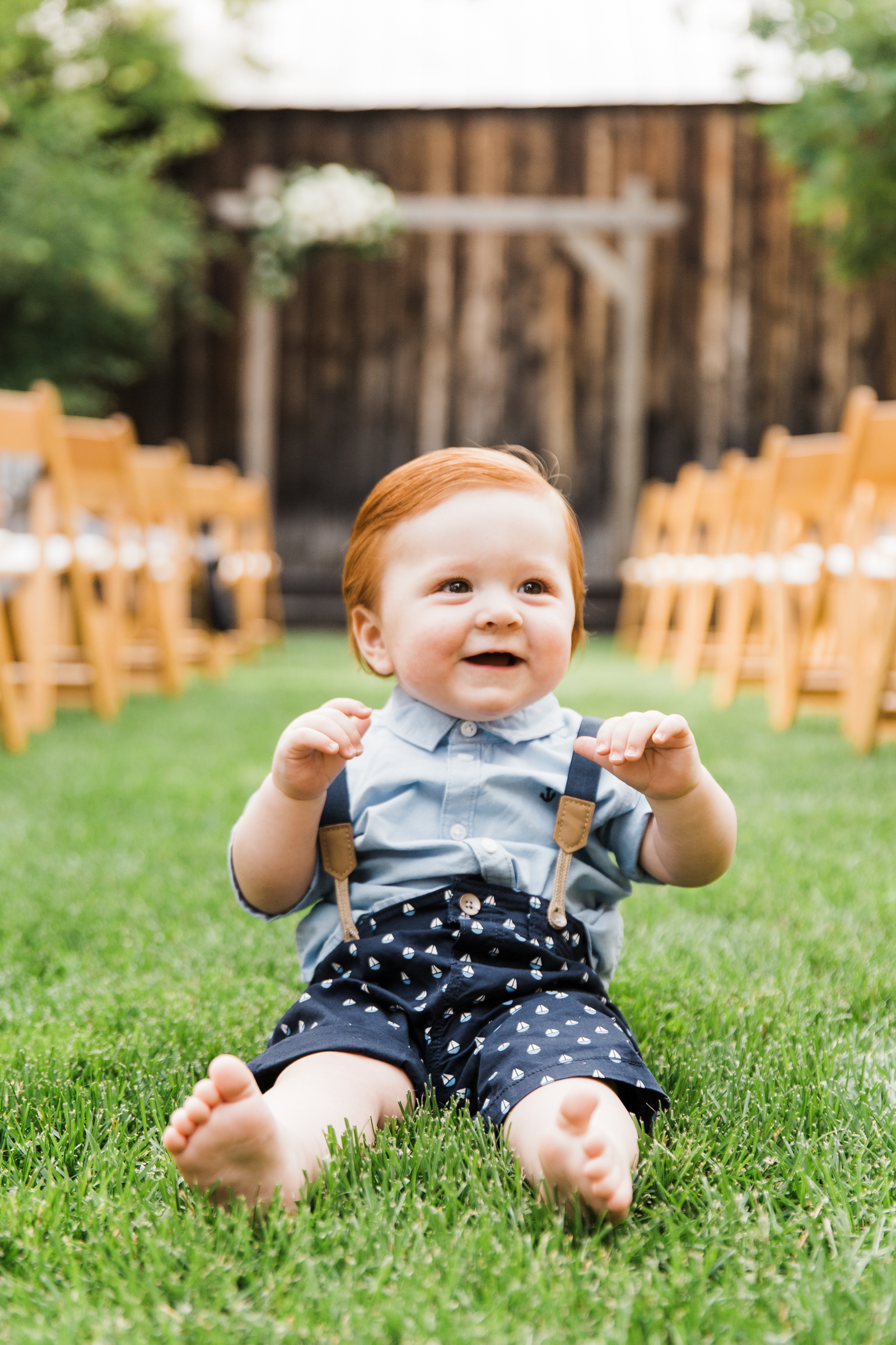 Baby in blue denim shirt, suspenders and boat design shorts - photo by Stephanie Cristalli - Seattle