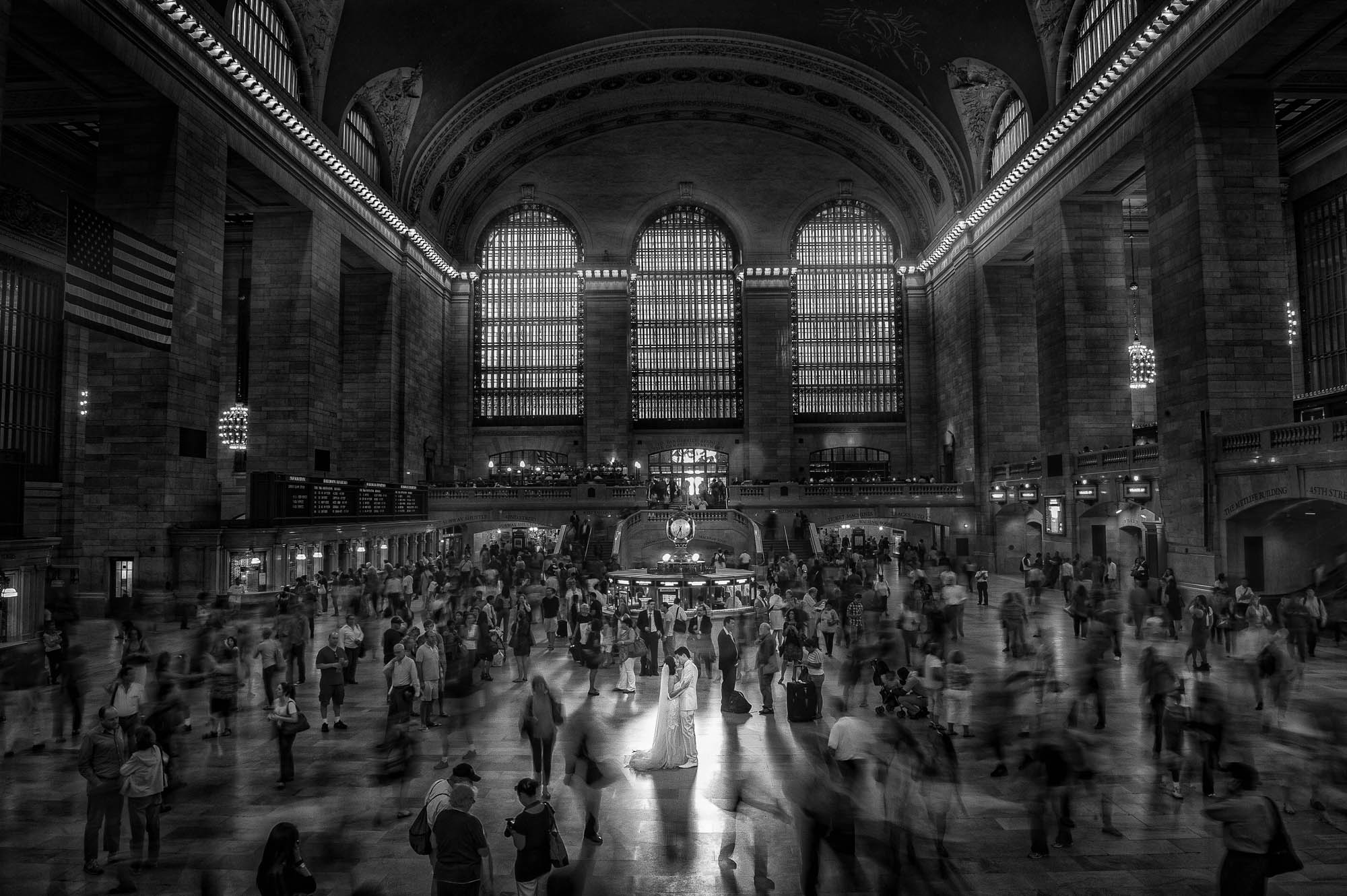 Long exposure of couple standing in Grand Central Station - photo by CM Leung