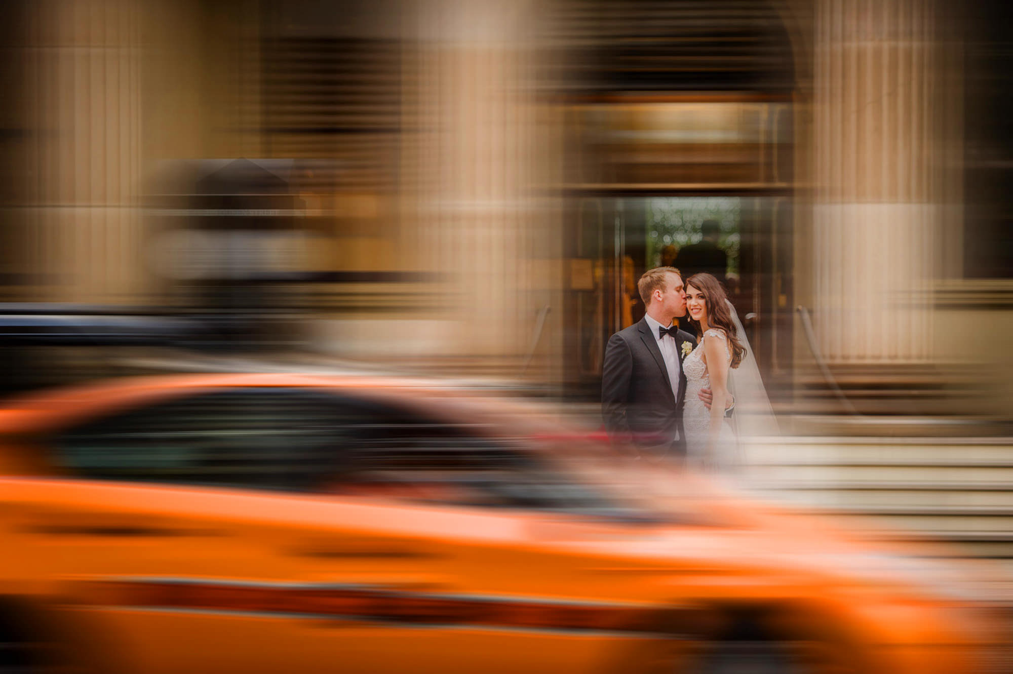 Long exposure couple portrait with cars blurred - photo by Marcus Bell of Studio Impressions