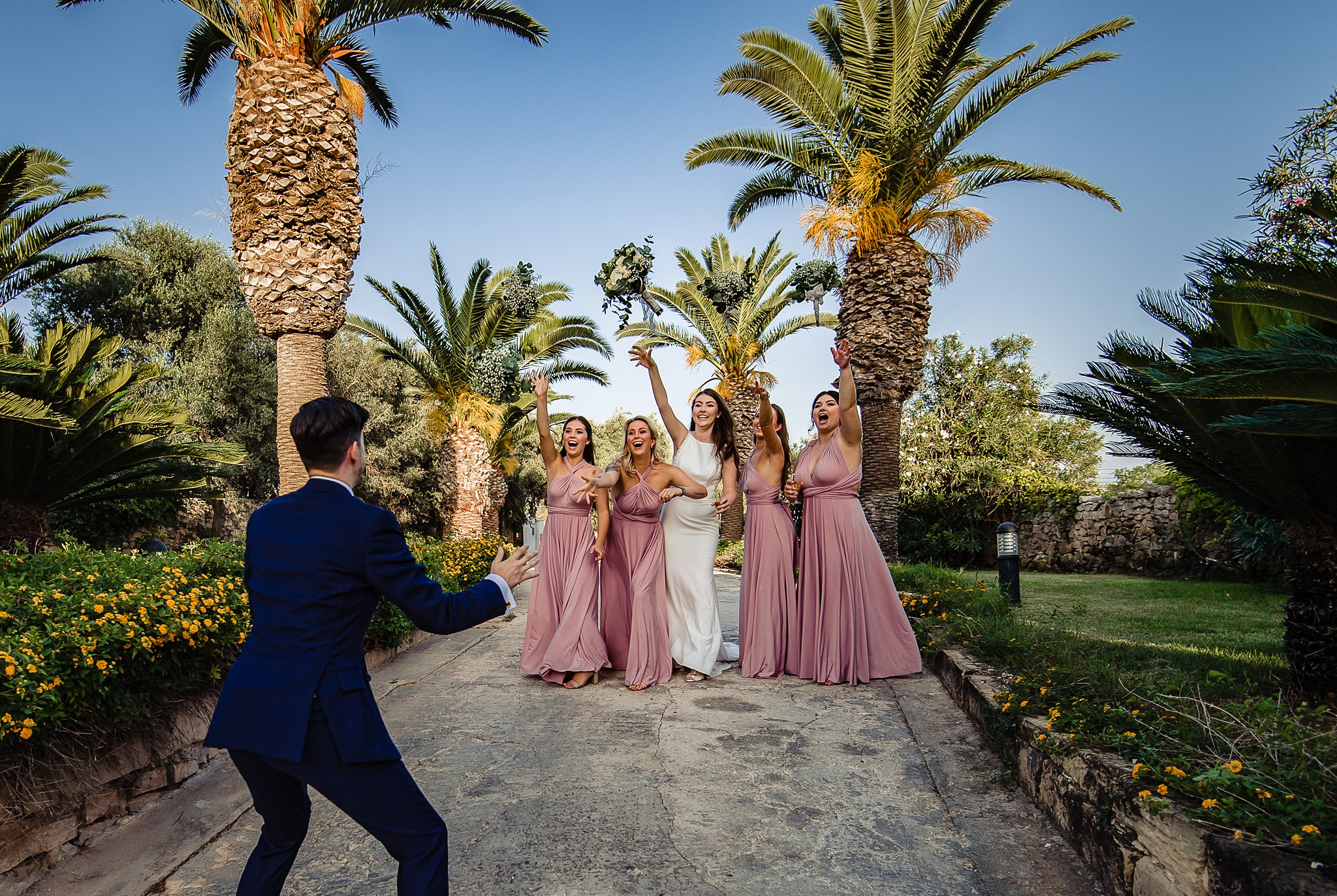 Bridesmaids wearing rose pink crepe dresses with crossed necklines - photographed by Shane P. Watts - Malta