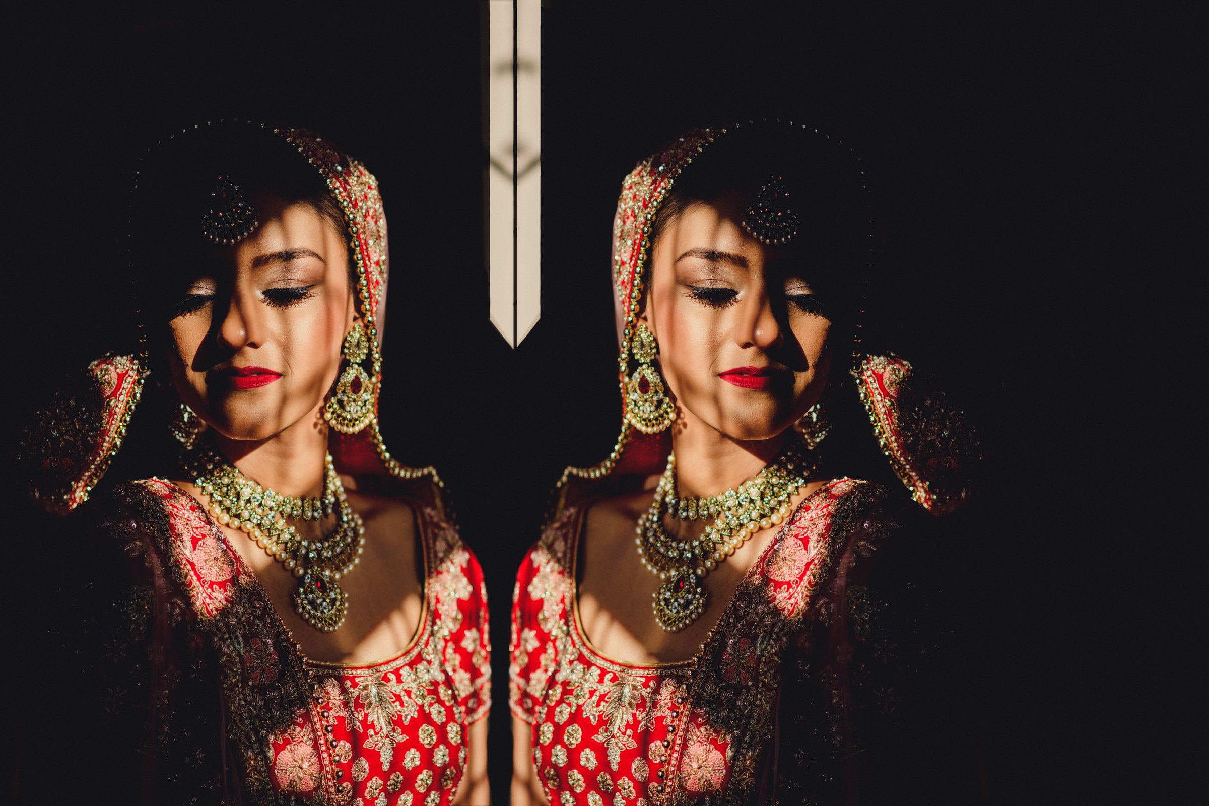 mirrored-photo-of-indian-bride-in-red-and-gold-photo-by-miki-studios