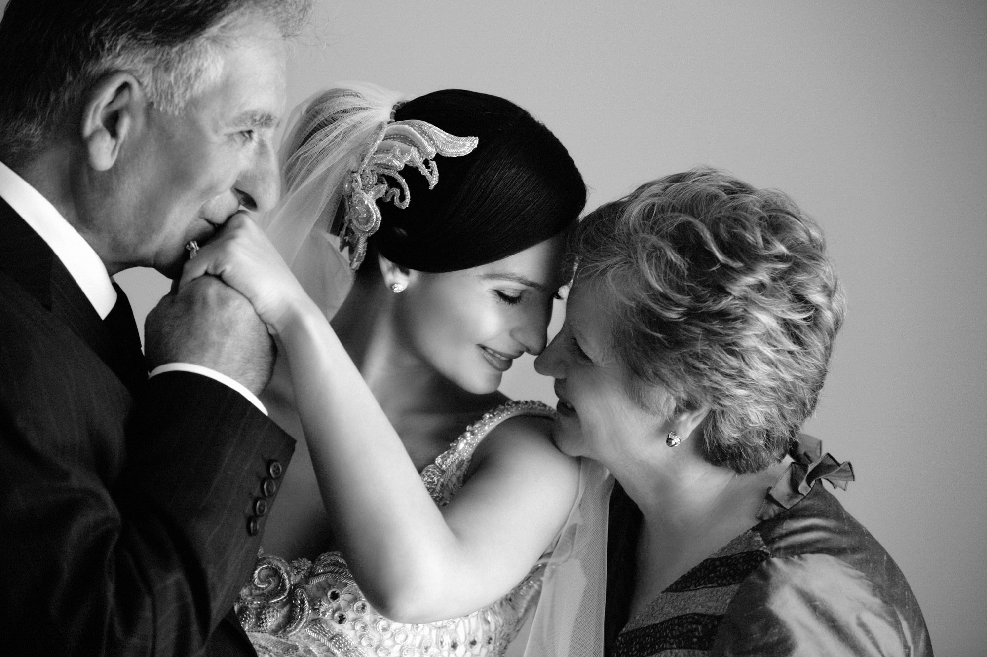 mom-dad-bride-share-sweet-touching-moment-best-wedding-photos-jerry-ghionis-top-las-vegas-photographer