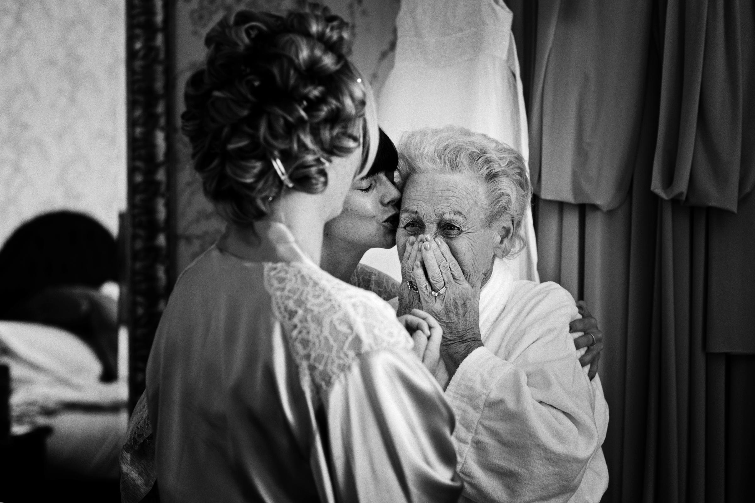 Grandma breaks down seeing bride in her wedding dress - photo by Jeff Ascough