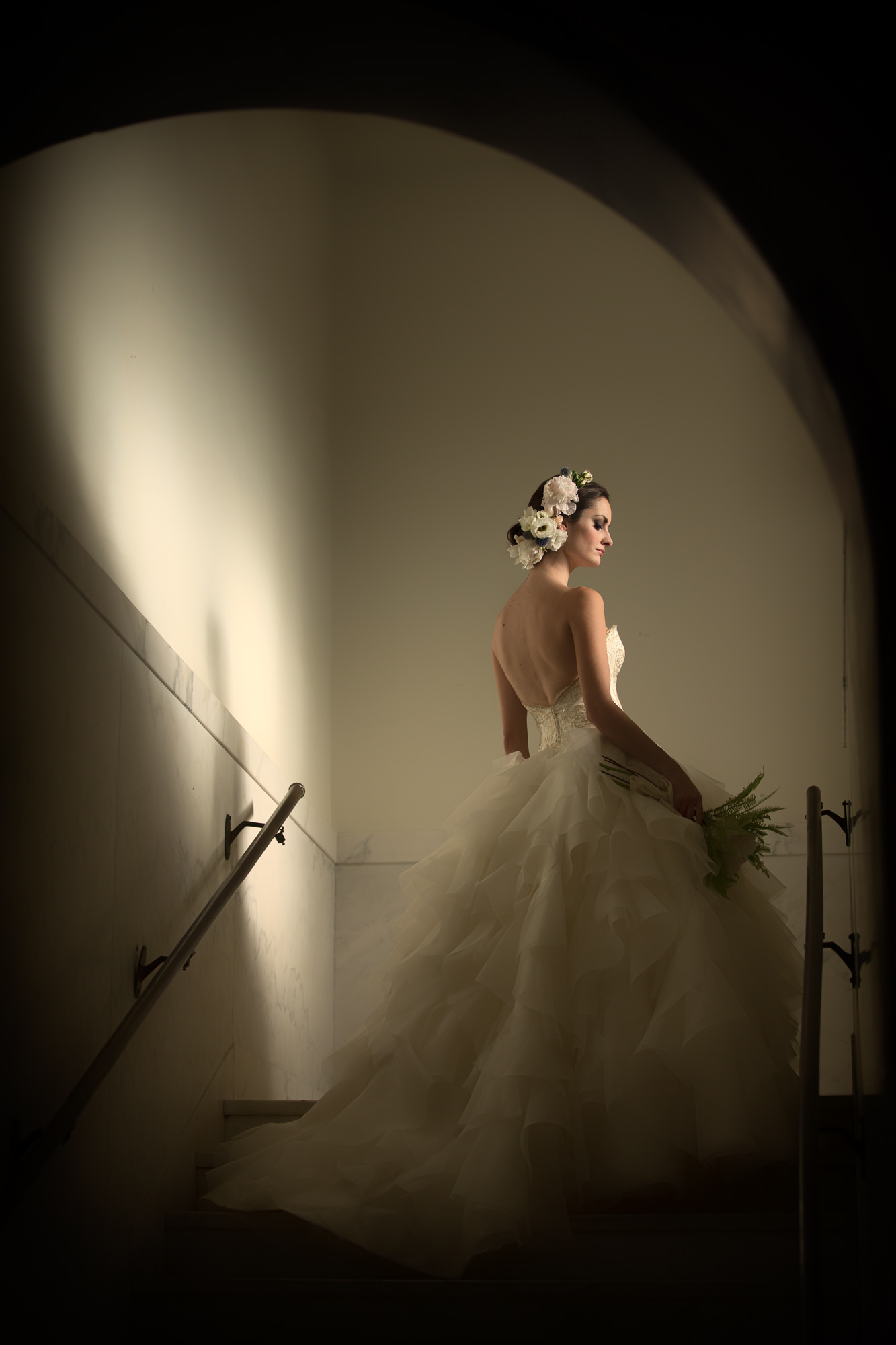 Bride in Monique Lhuillier backless ruffled gown by Roberto Valenzuela, Los Angeles