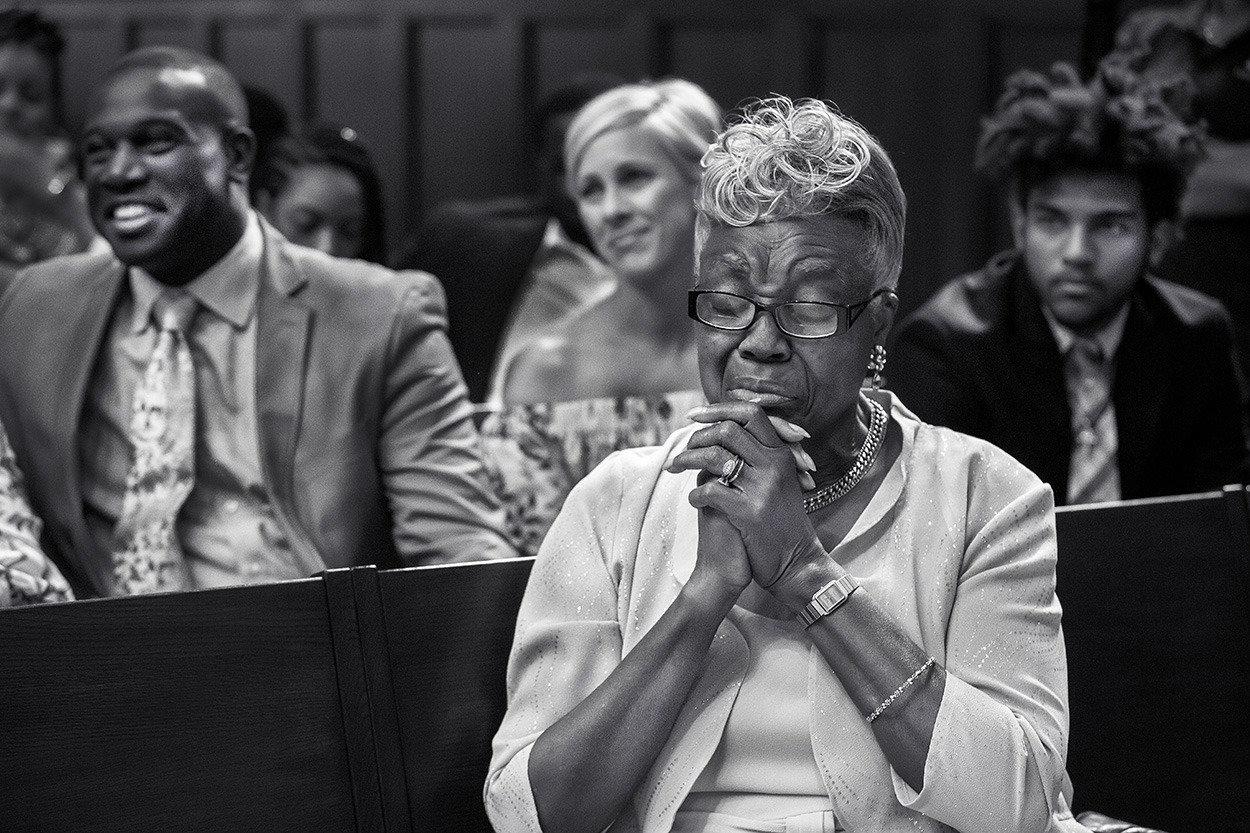 mother-prays-during-wedding-ceremony-photo-by-amber-henry-photography-michigan