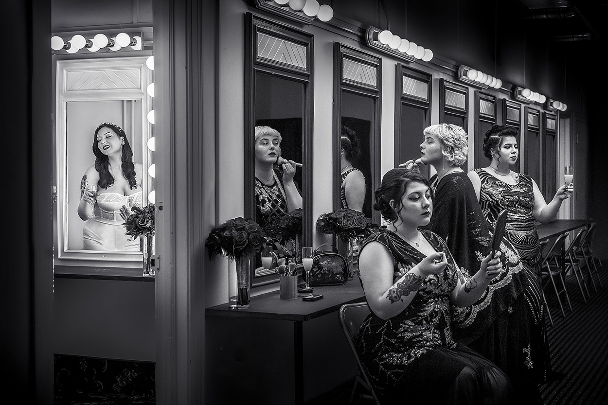 Bridal party getting ready reflected in make-up mirrors - photo by Amber Henry Photography - Michigan