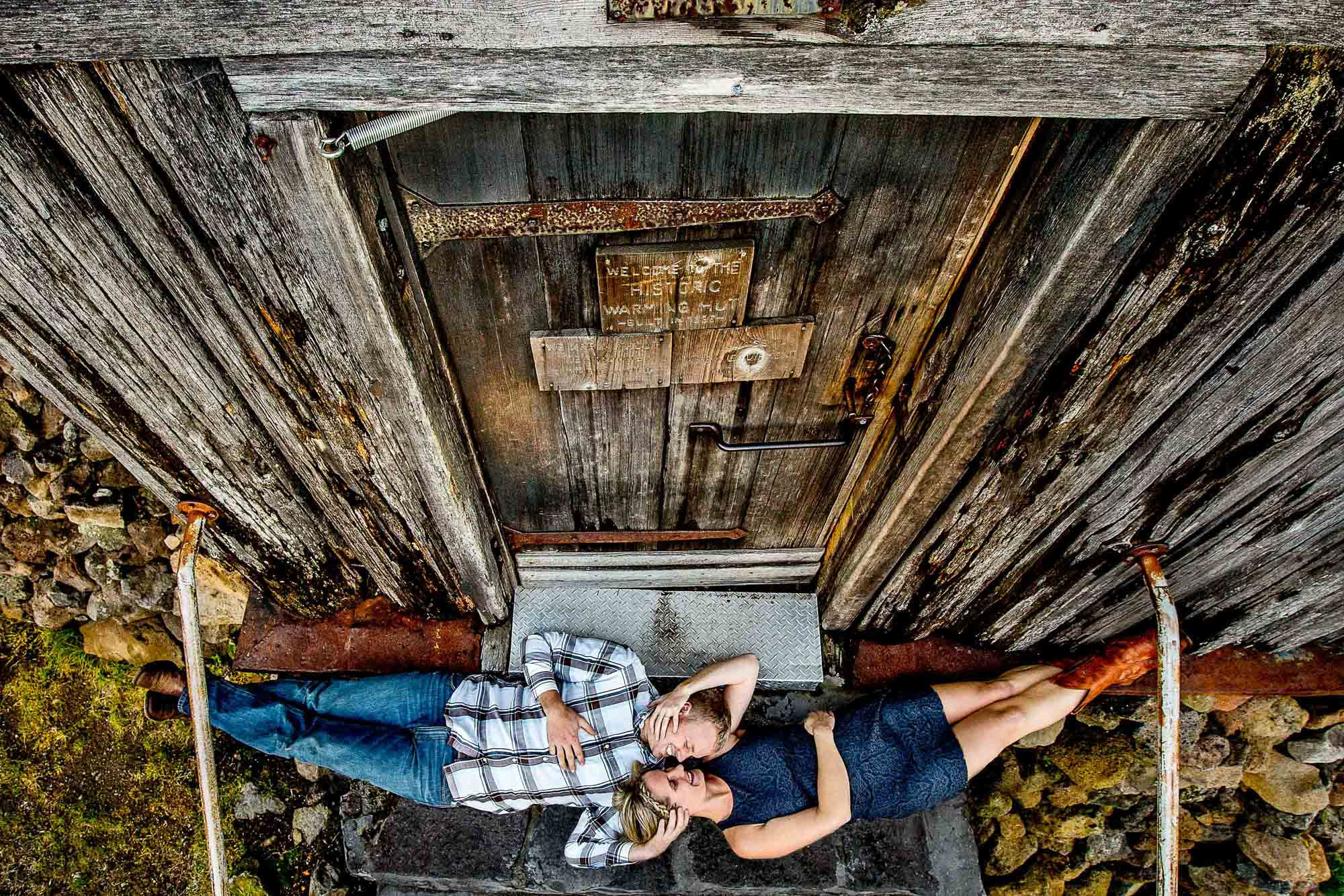 Portrait of couple with heads togethers taken from above by JOS STUDIOS