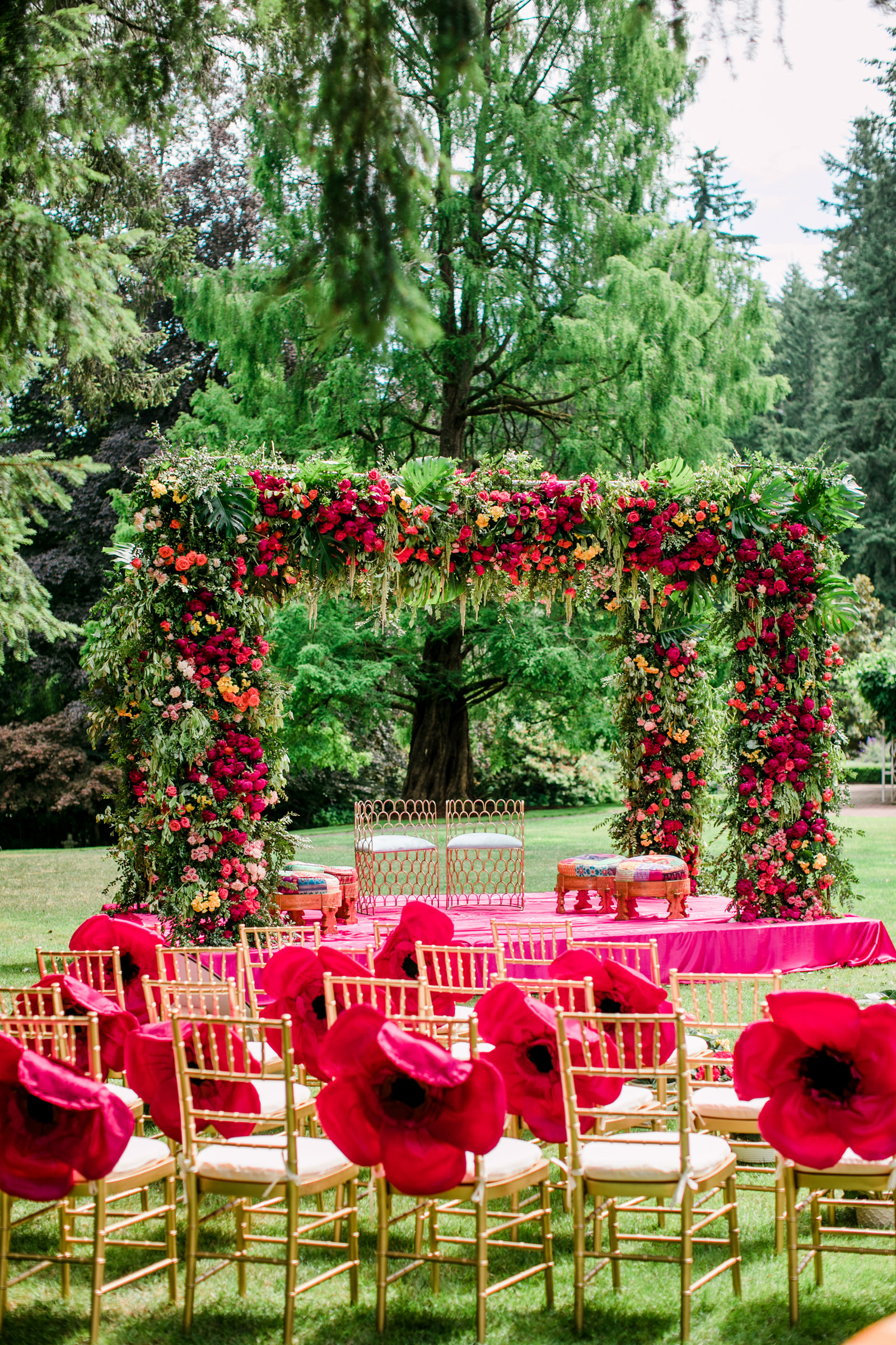 Paper poppies on chair backs for outdoor ceremony photographed by Into Dust Photography - Seattle