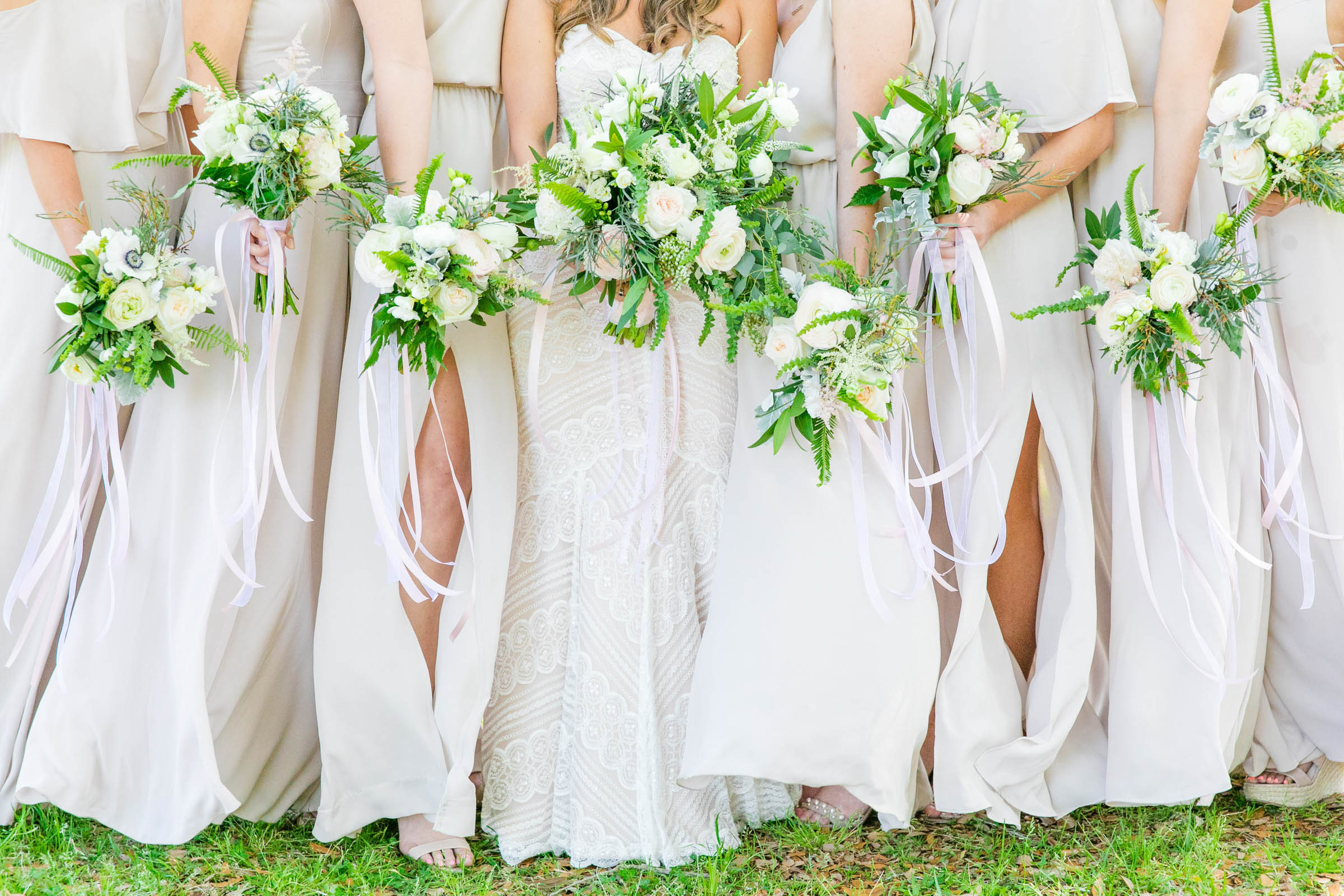 Off-white flowing bridal party dresses and floral bouquets - photographed by Dana Cubbage - South Carolina
