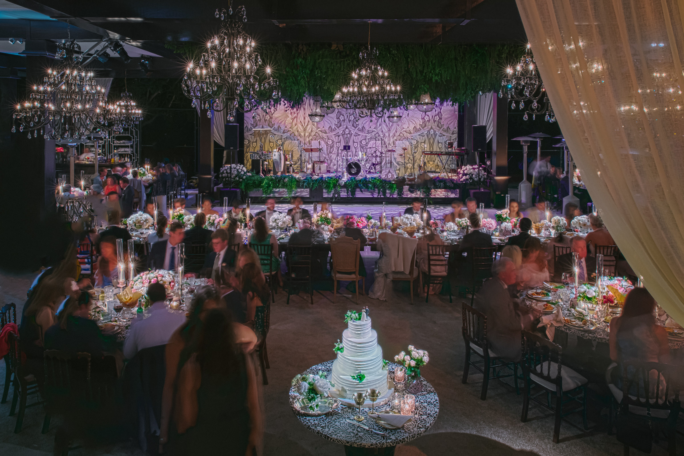 Reception dinner with chandeliers and cake by Amy and Stuart of Los Angeles