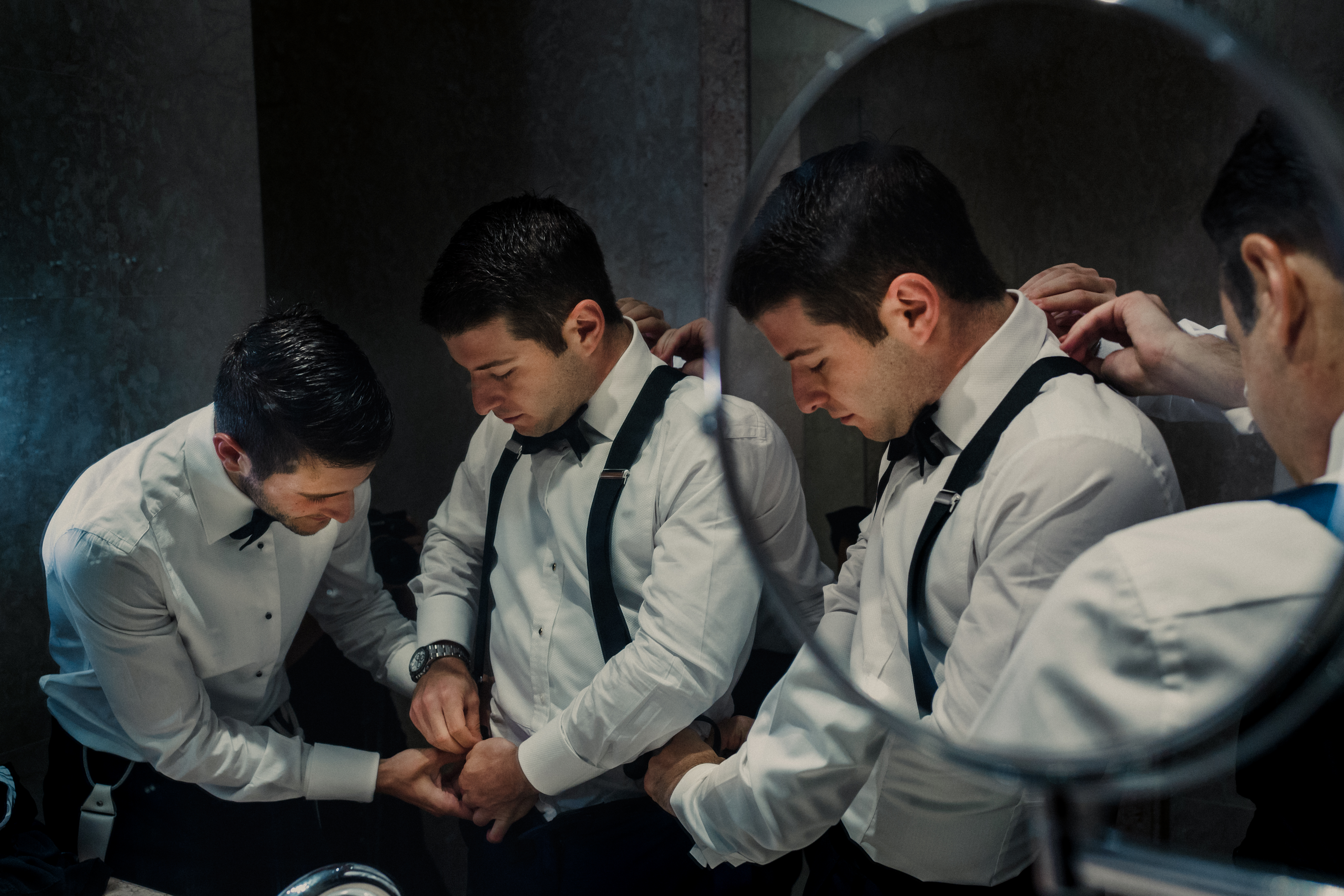Groom getting ready, reflected in multiple mirrors - photo by El Marco Rojo - Spain