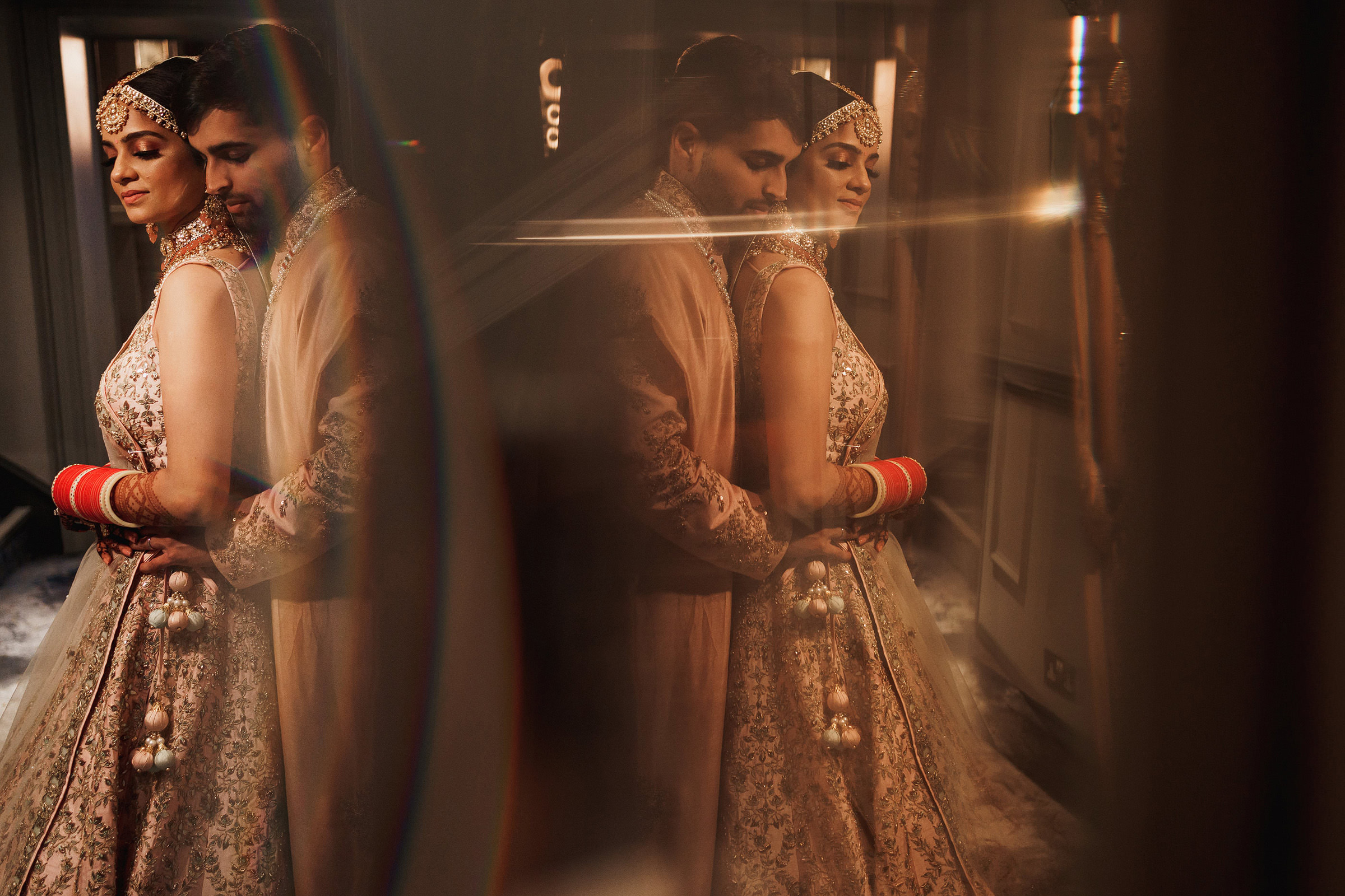 Indian bride and groom reflected in mirror - photo by f5 London photographer