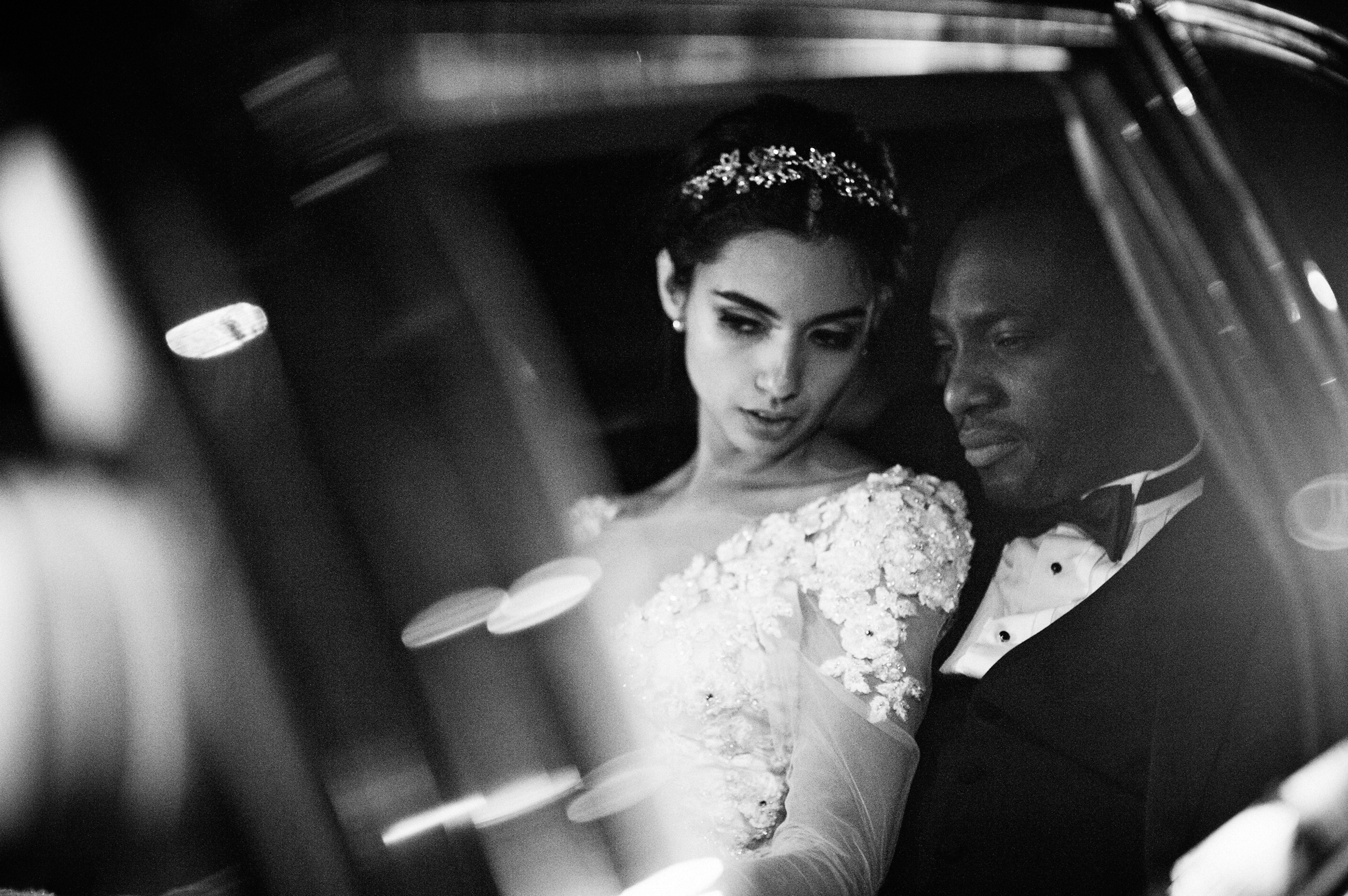 Couple in limousine leans in to one another - photo by Richard Israel - North Carolina