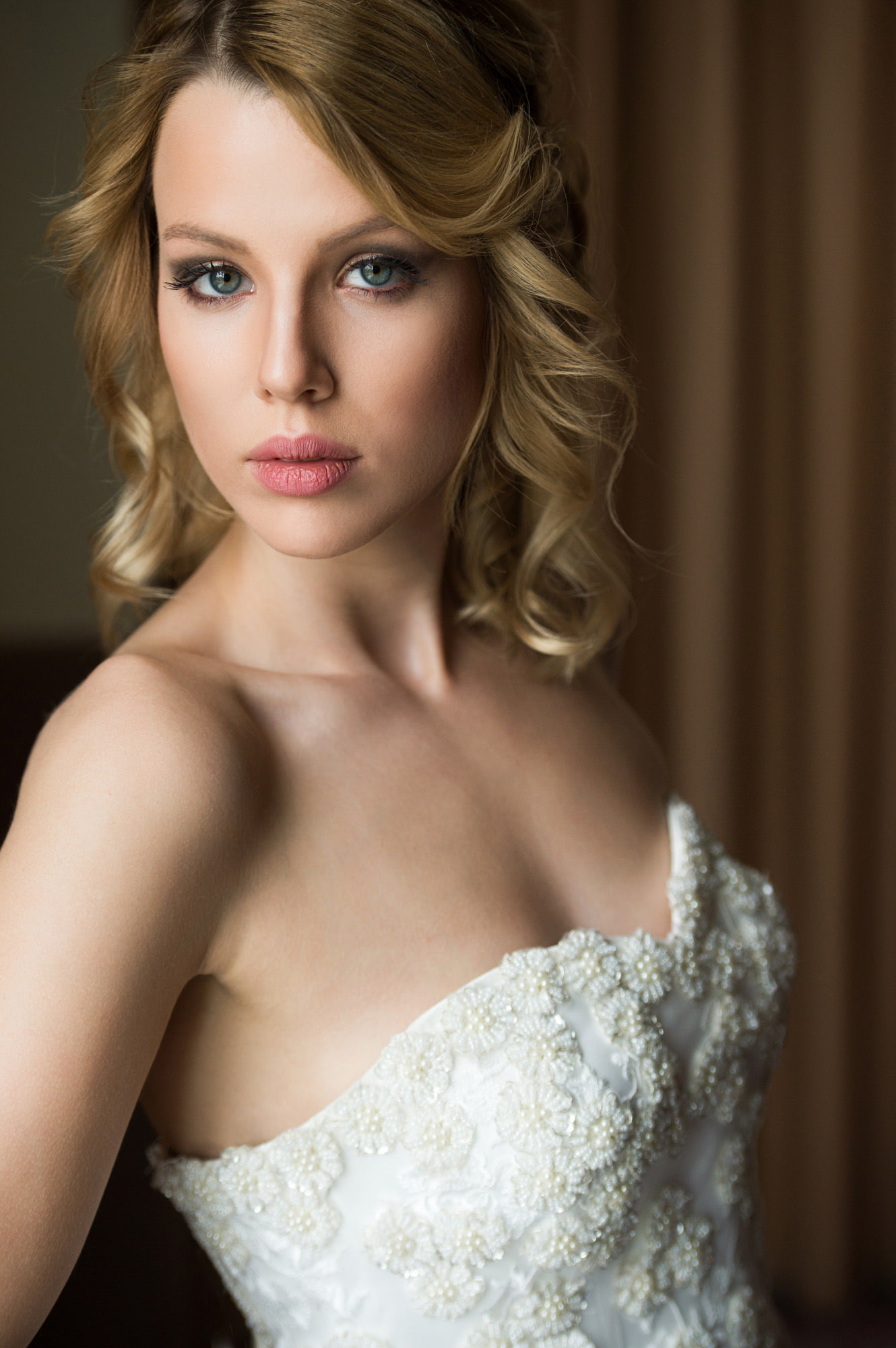 Blonde bride with rose lips and grey and silver eyeshadow - photo by Jerry Ghionis - Las Vegas