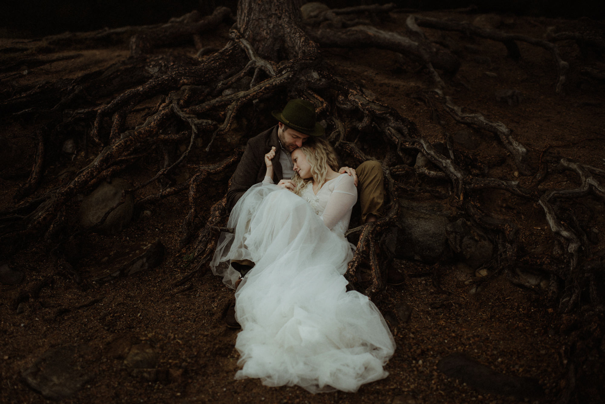 romantic-portrait-couple-laying-in-trees-together-dark-moody-worlds-best-wedding-photos-the-kitcheners-scotland-wedding-photographers