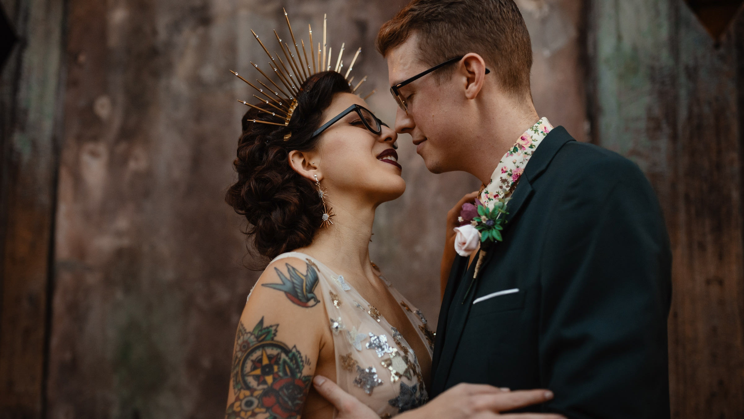 stylish-bride-with-tattoos-and-bronze-tiara-and-groom-with-floral-shirt-dark-roux-louisiana