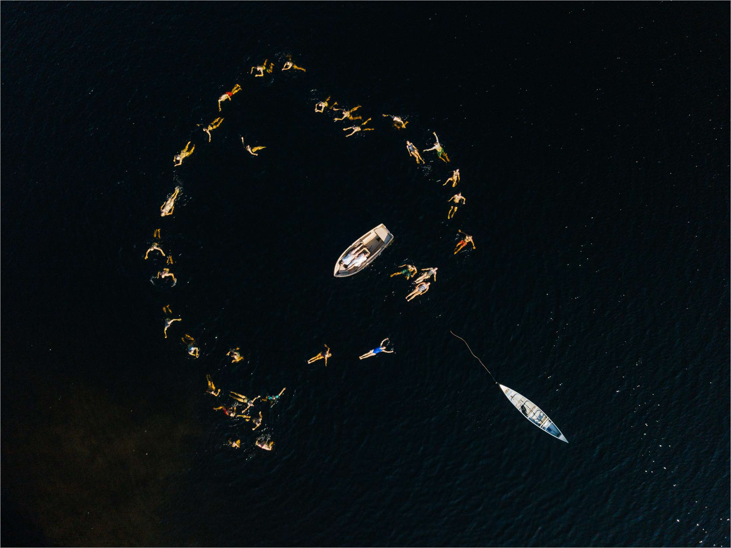 Swimmers create heart around bride and grooms boat - photo by The Crawleys - Scotland