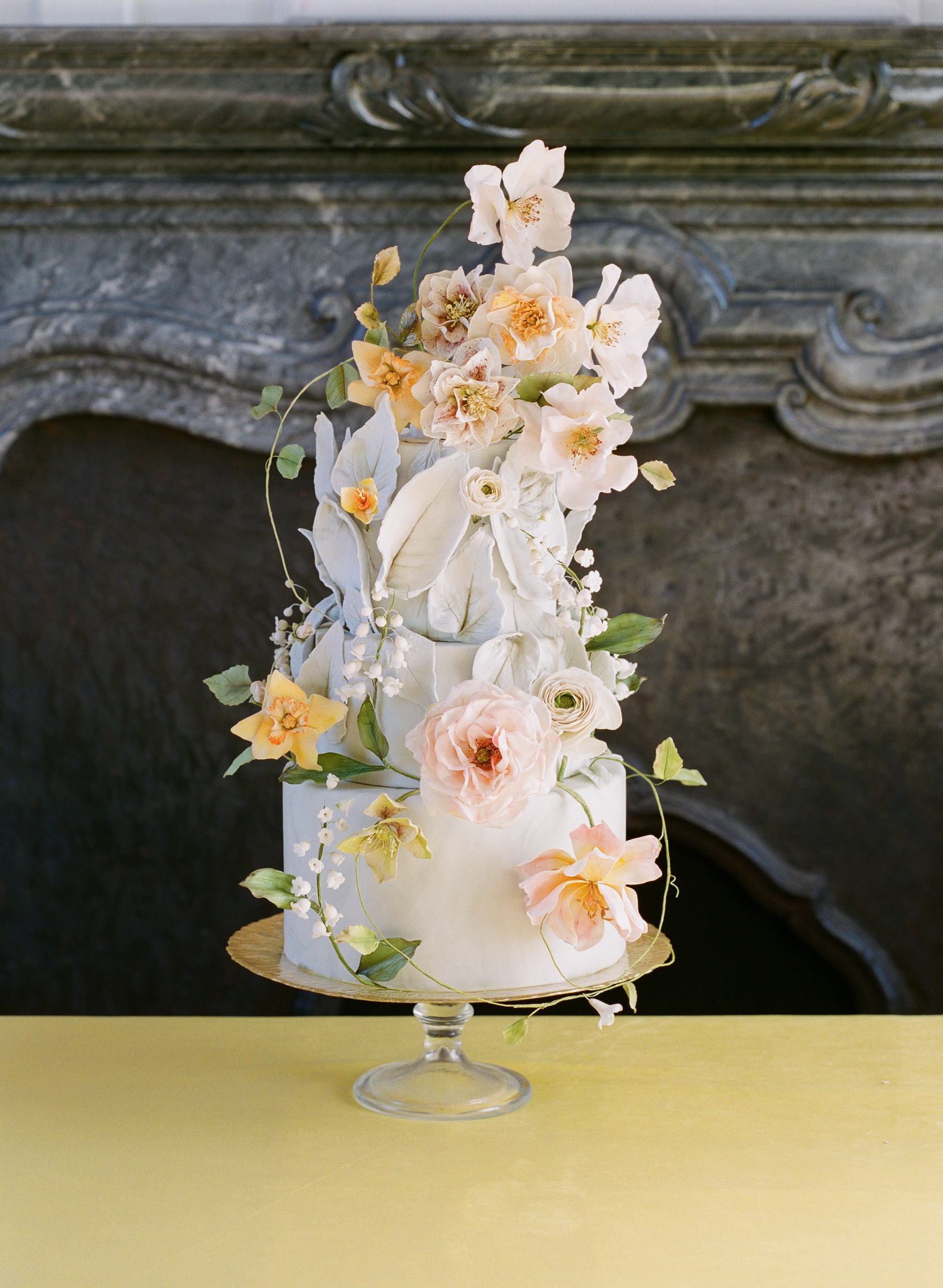 tiered-wedding-cake-decorated-with-yellow-and-pink-flowers-photo-by-corbin-gurkin-worlds-best-wedding-photos