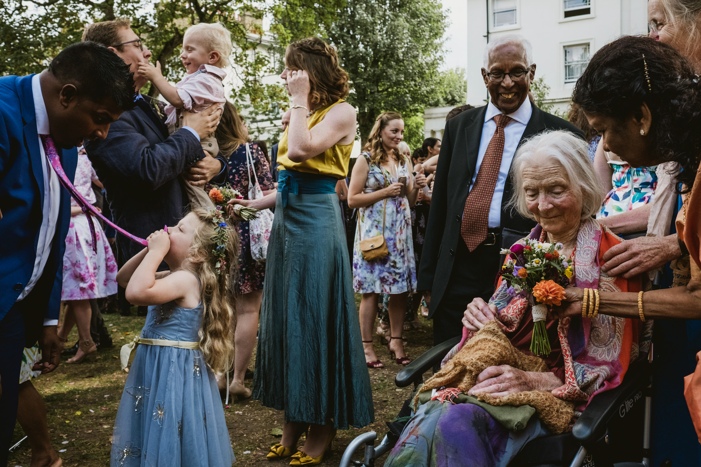 Documentary outdoor reception photo by UK wedding photographers York Place Studios