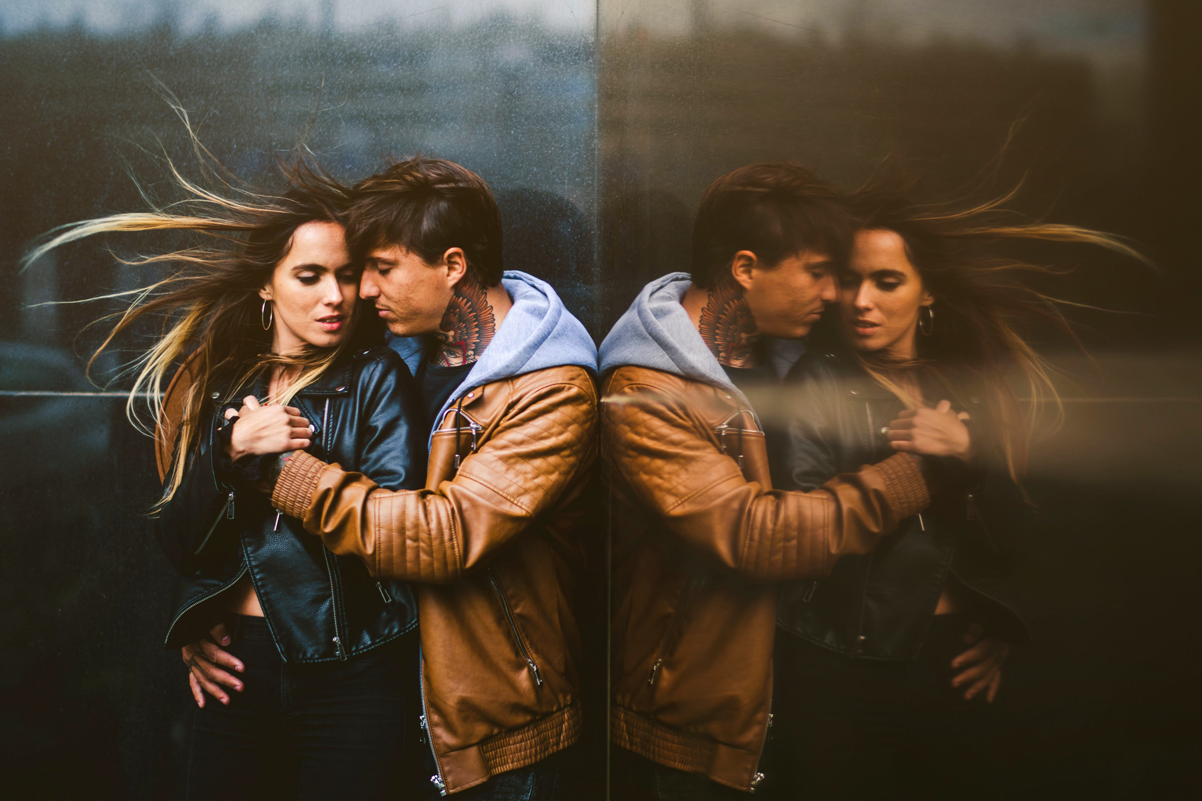 Couple reflected in marble wall - photo by Sam Hurd