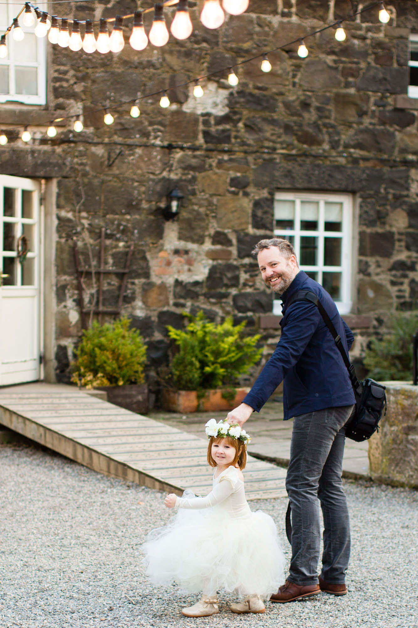 Adorable flower girl with tulle dress holds hands with daddy photo by  La Vie