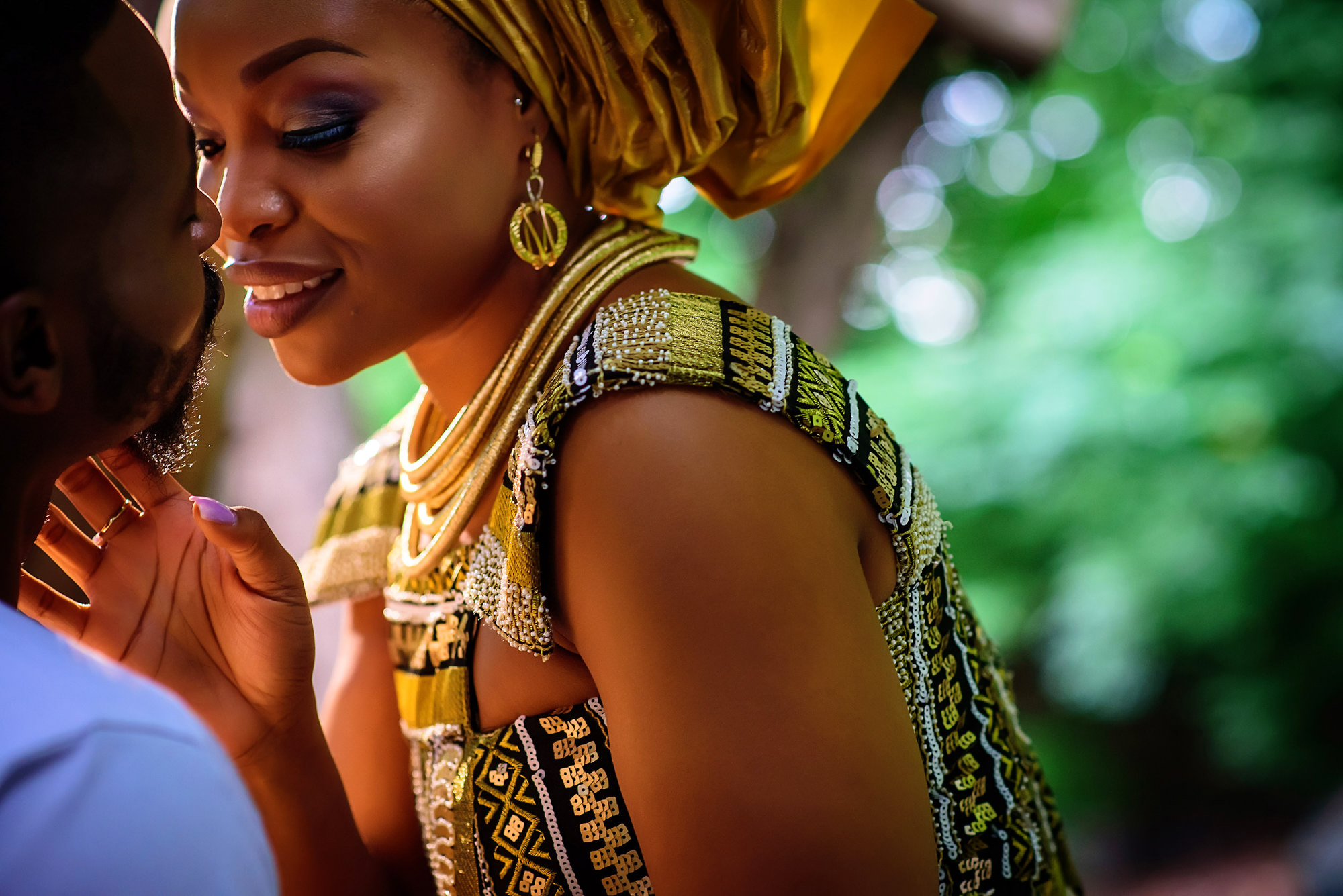 Bride in beaded African wedding dress - photo by Jide Alakija