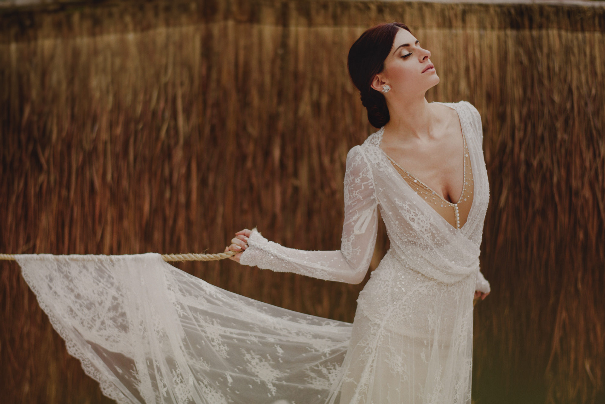 Bride wearing sheer lace gown with gold bodice - photo by Fer Juaristi