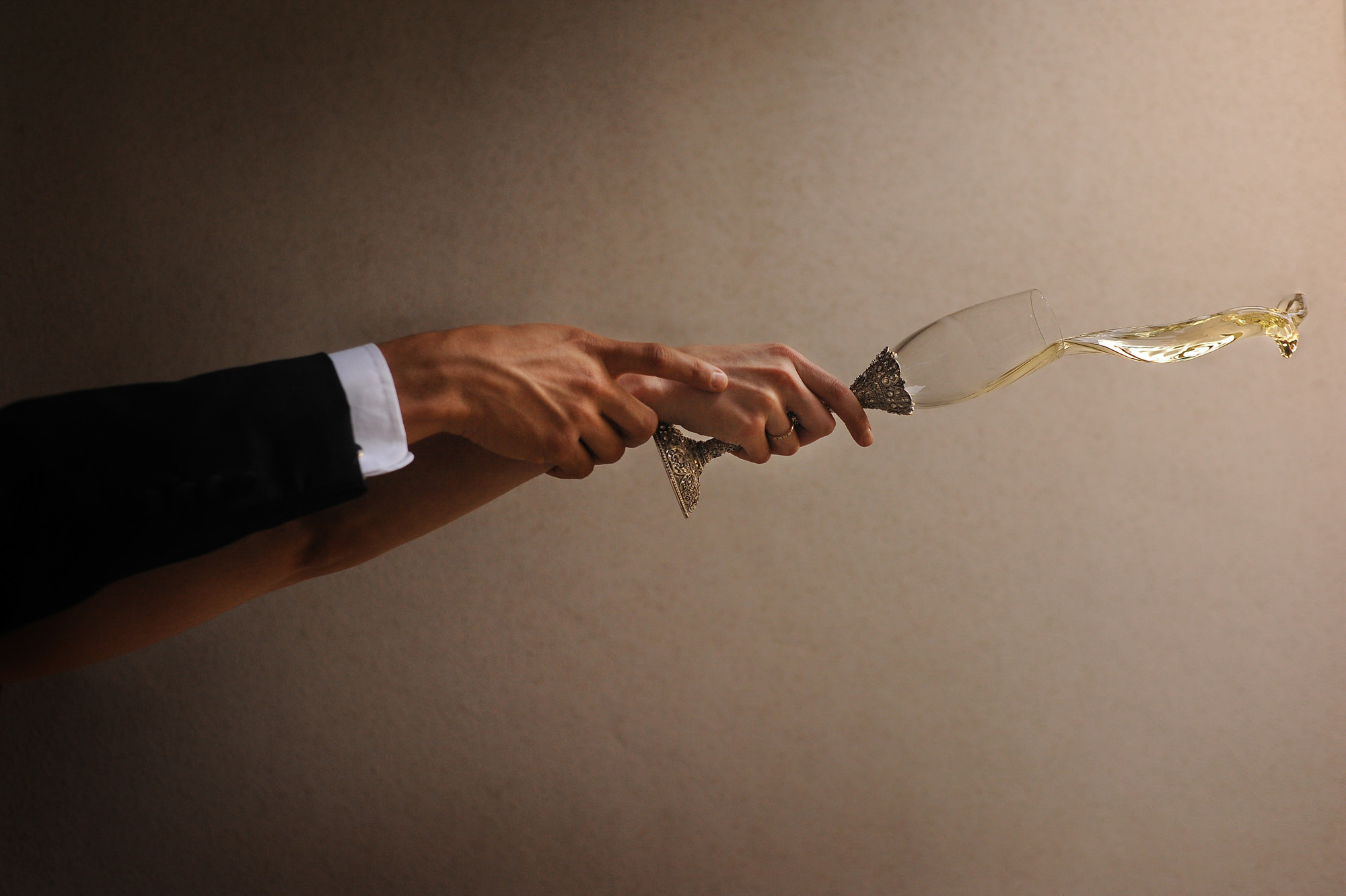 Artistic portrait of hands throwing champagne - photo by Daniel Aguilar