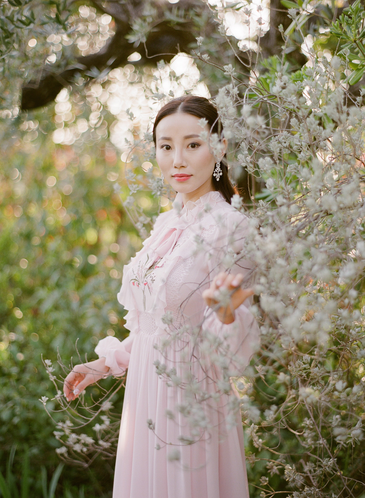 Asian bride in pink lace gown near spring flowers - Greg Finck Photography