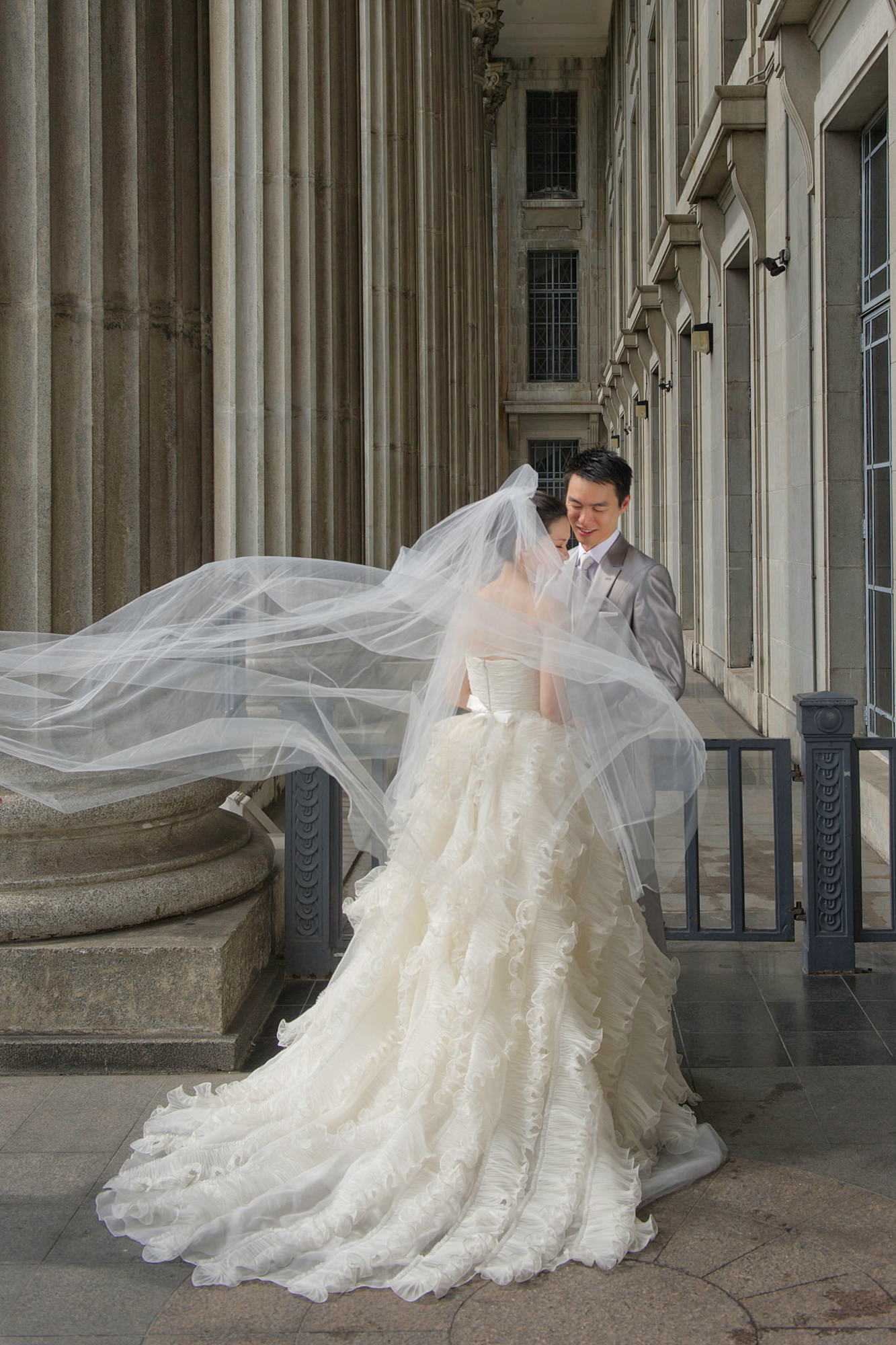 Classic portrait of groom and bride with blowing veil - Studio Impressions Photography