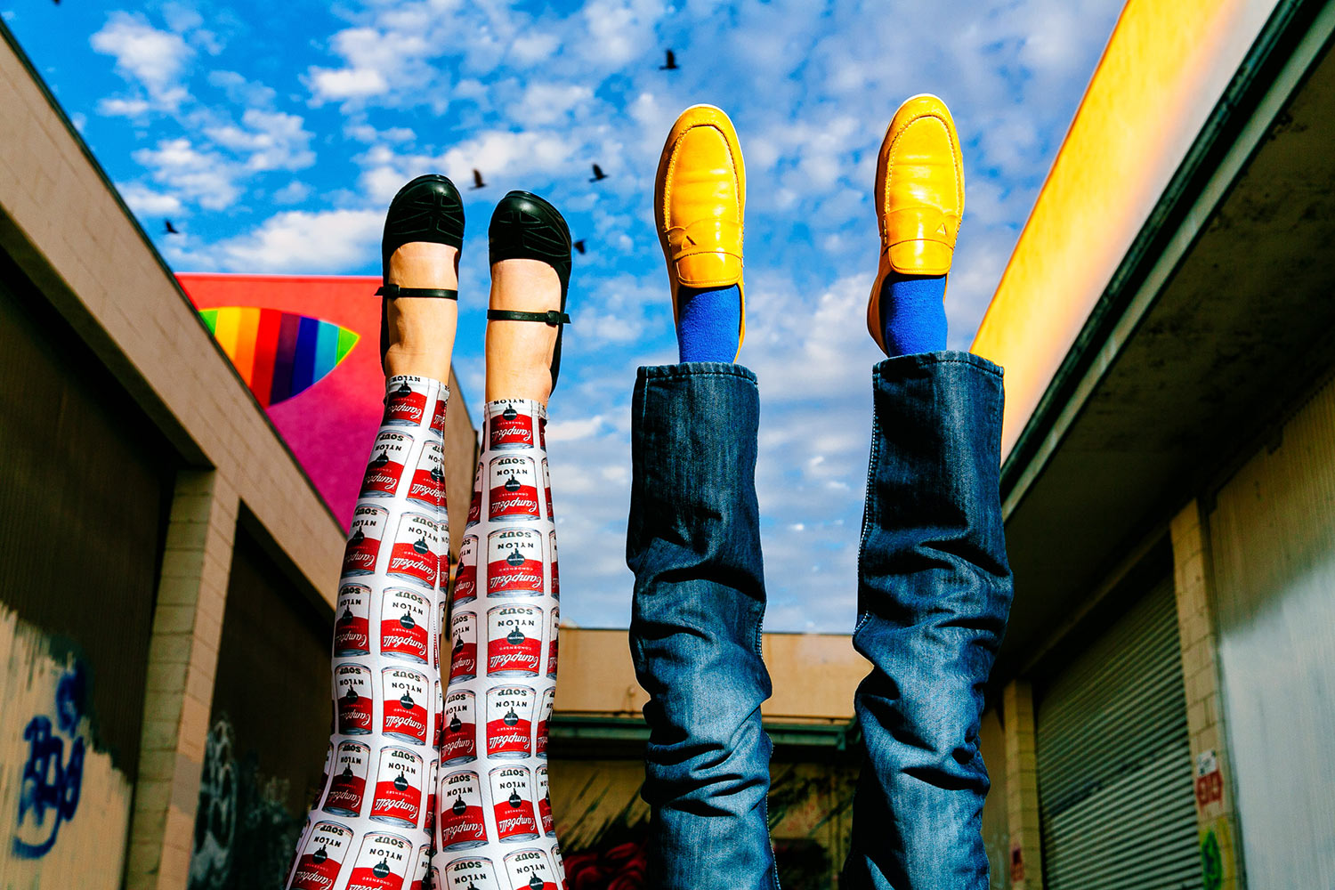 Fun photo of couple with colorful pants and shoes, feet up, by Callaway Gable