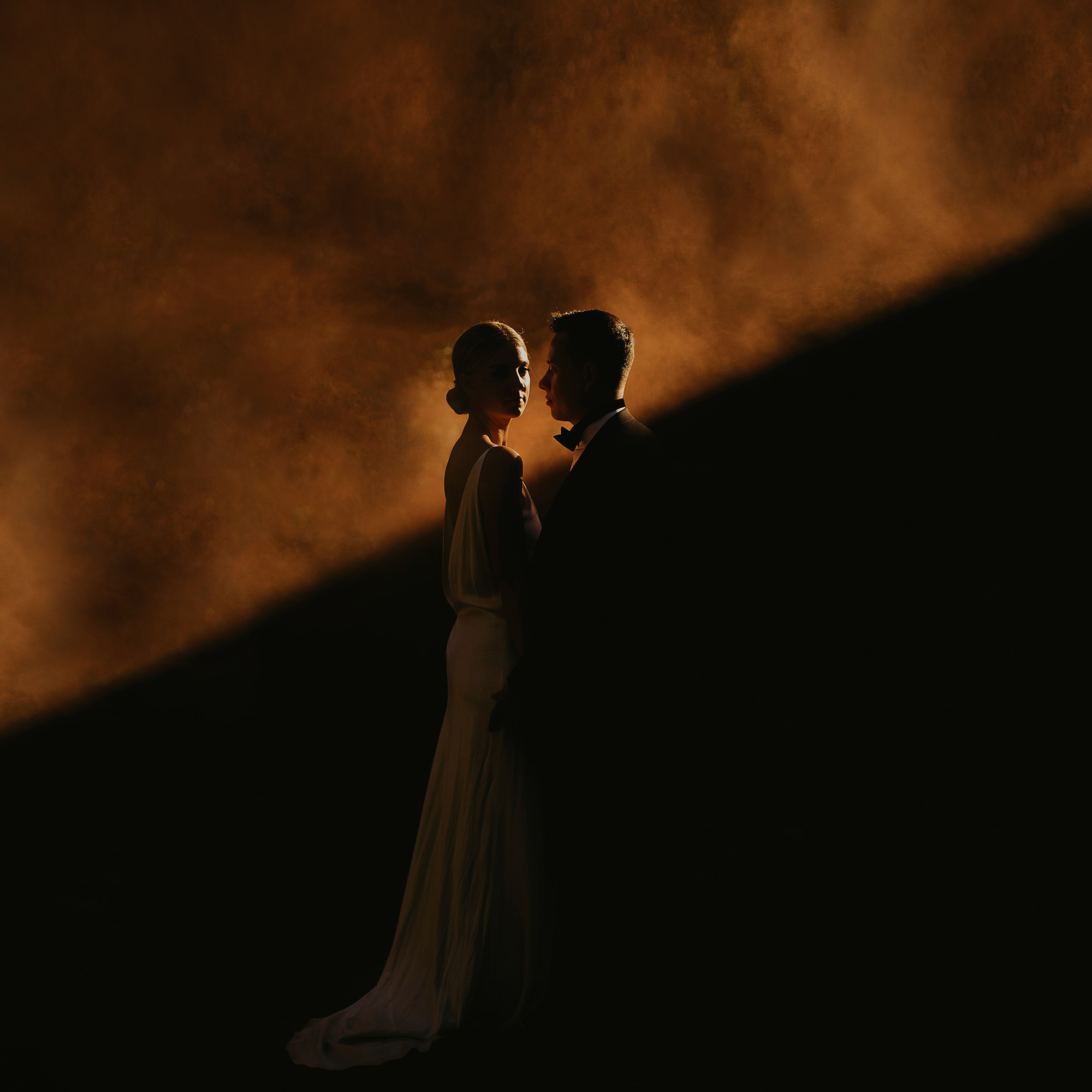 Smokey and dramatic lit bride and groom - photo by Dan O'Day