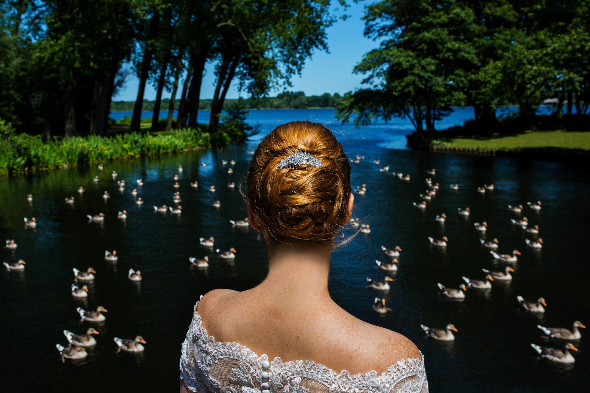 Back of bride with updo and off-shoulder dress photo by Fotobelle: Isabelle Hattink