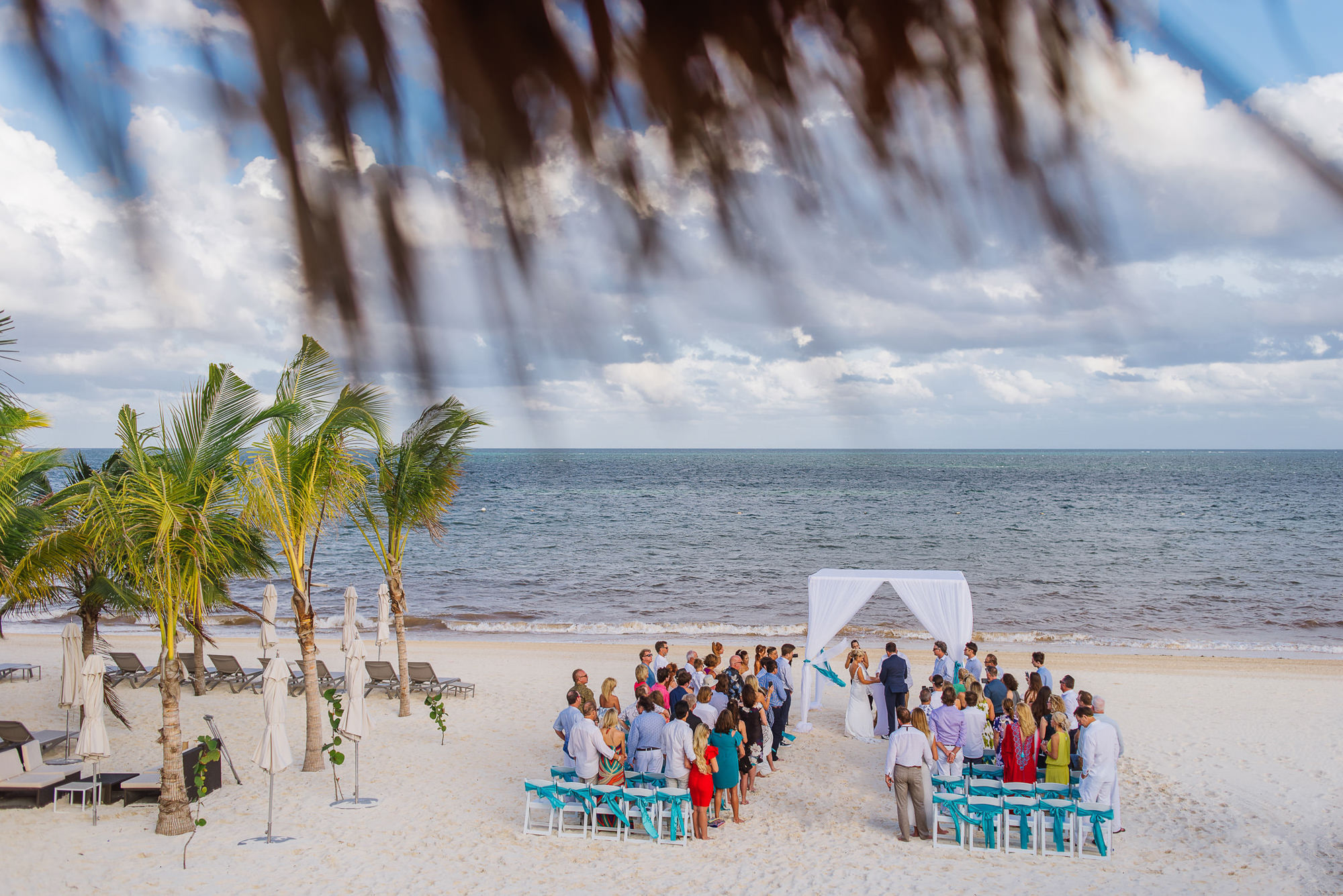 Beach wedding ceremony scene, by Citlalli Rico
