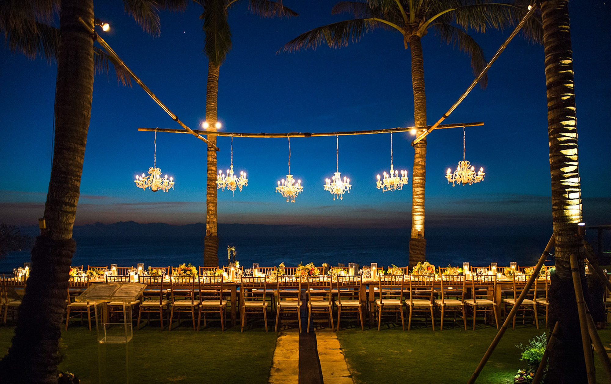 Waterfront reception decor at night with chandeliers - Studio Impressions Photography