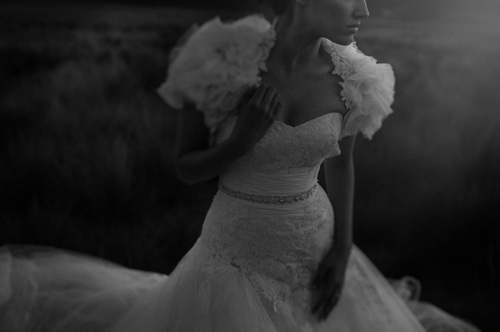 Ethereal portrait of bride with lace dress and ruffled bolero
