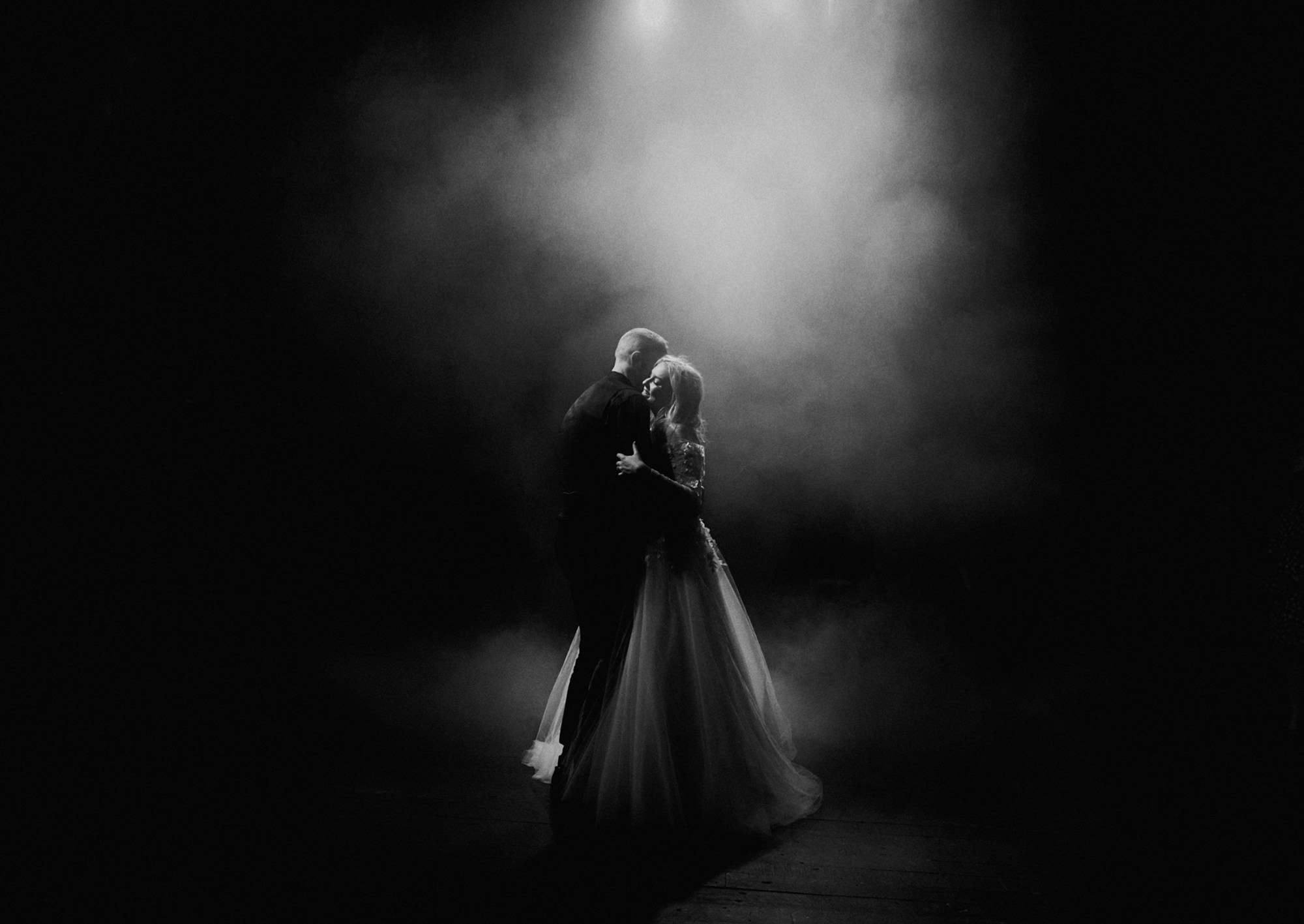 Bride and groom dancing on smokey dance floor - photo by Dan O'Day