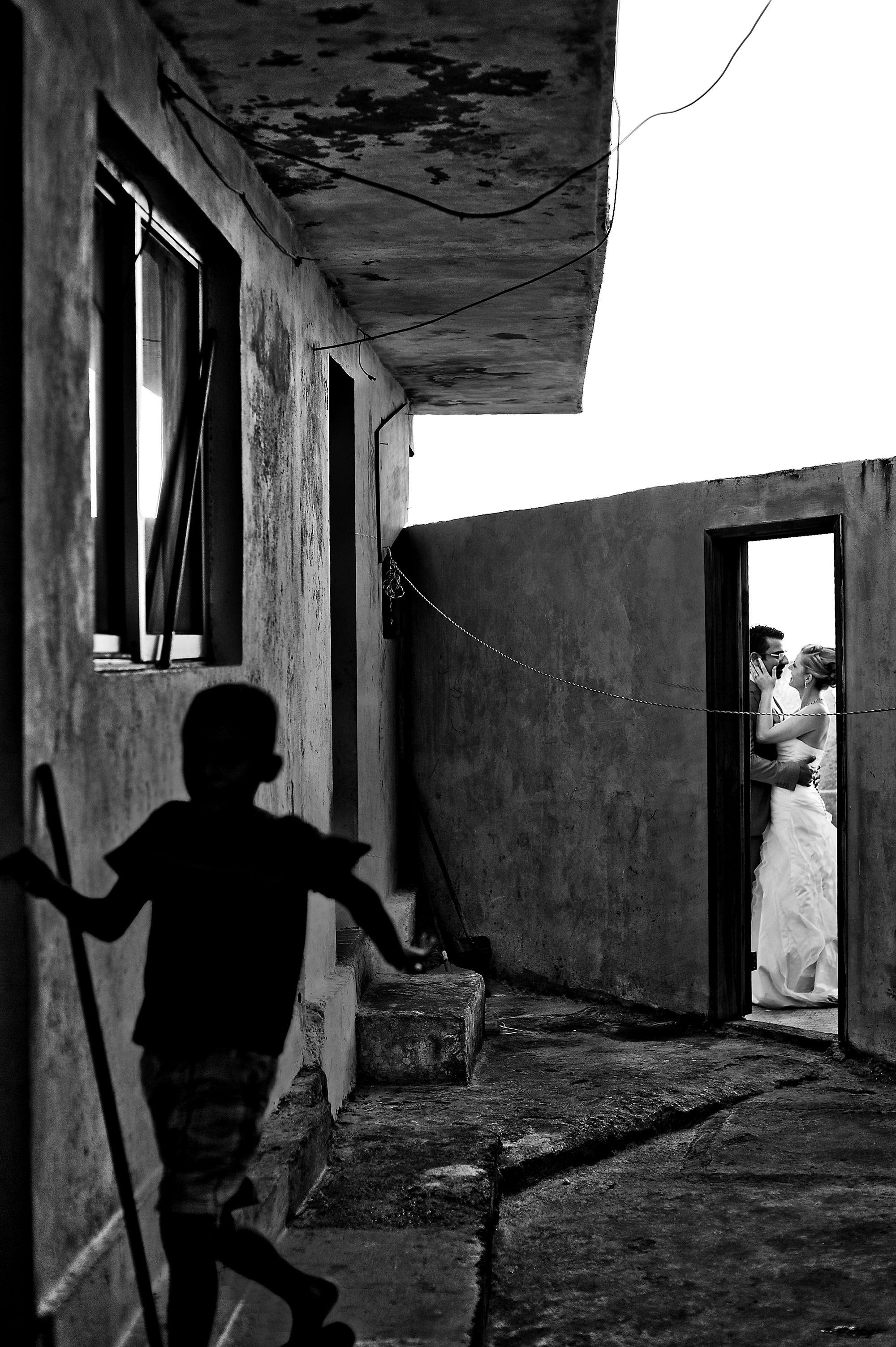 Couple framed in doorway - Davina + Daniel