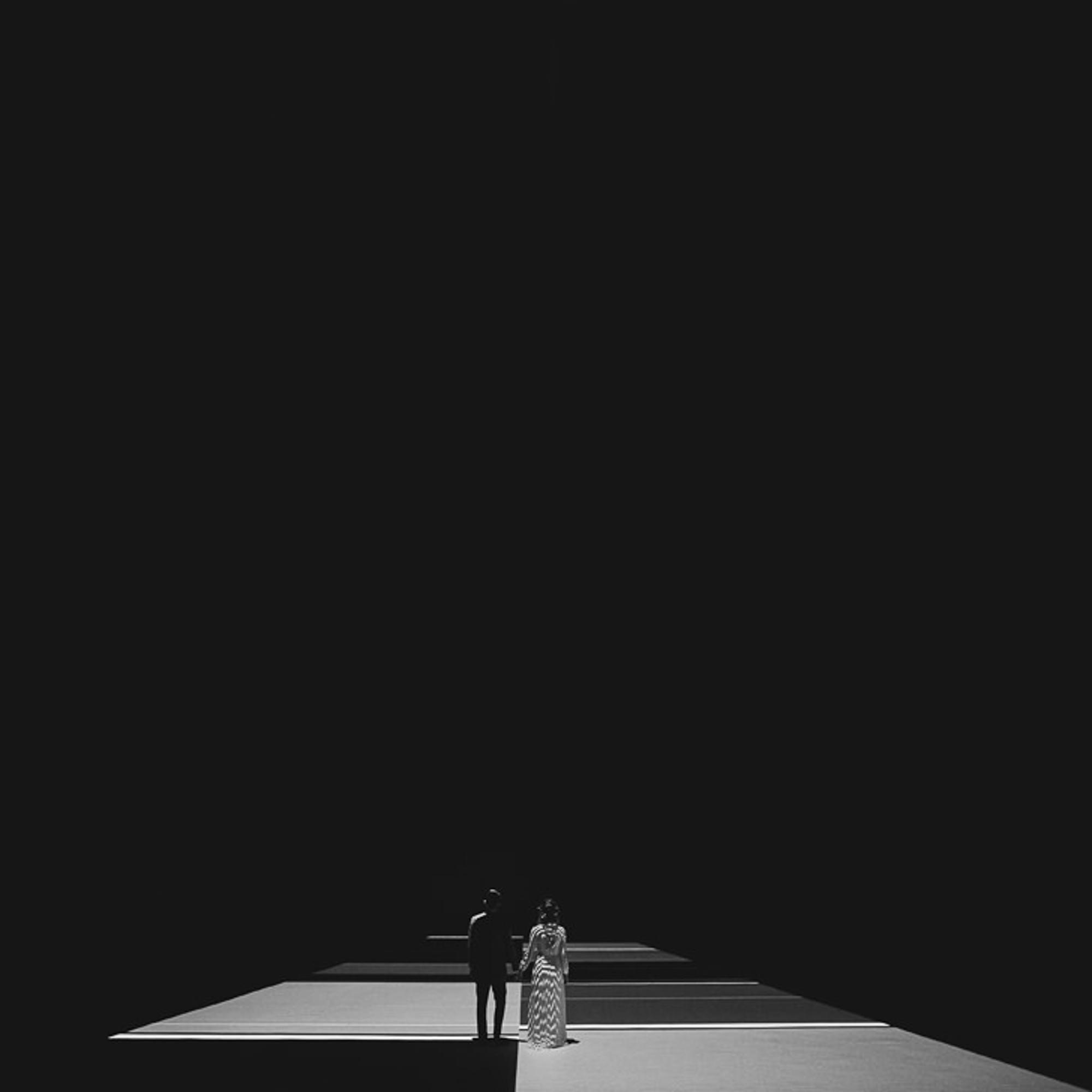 Wedding couple portrait on geometric floor- photo by Dan O'Day