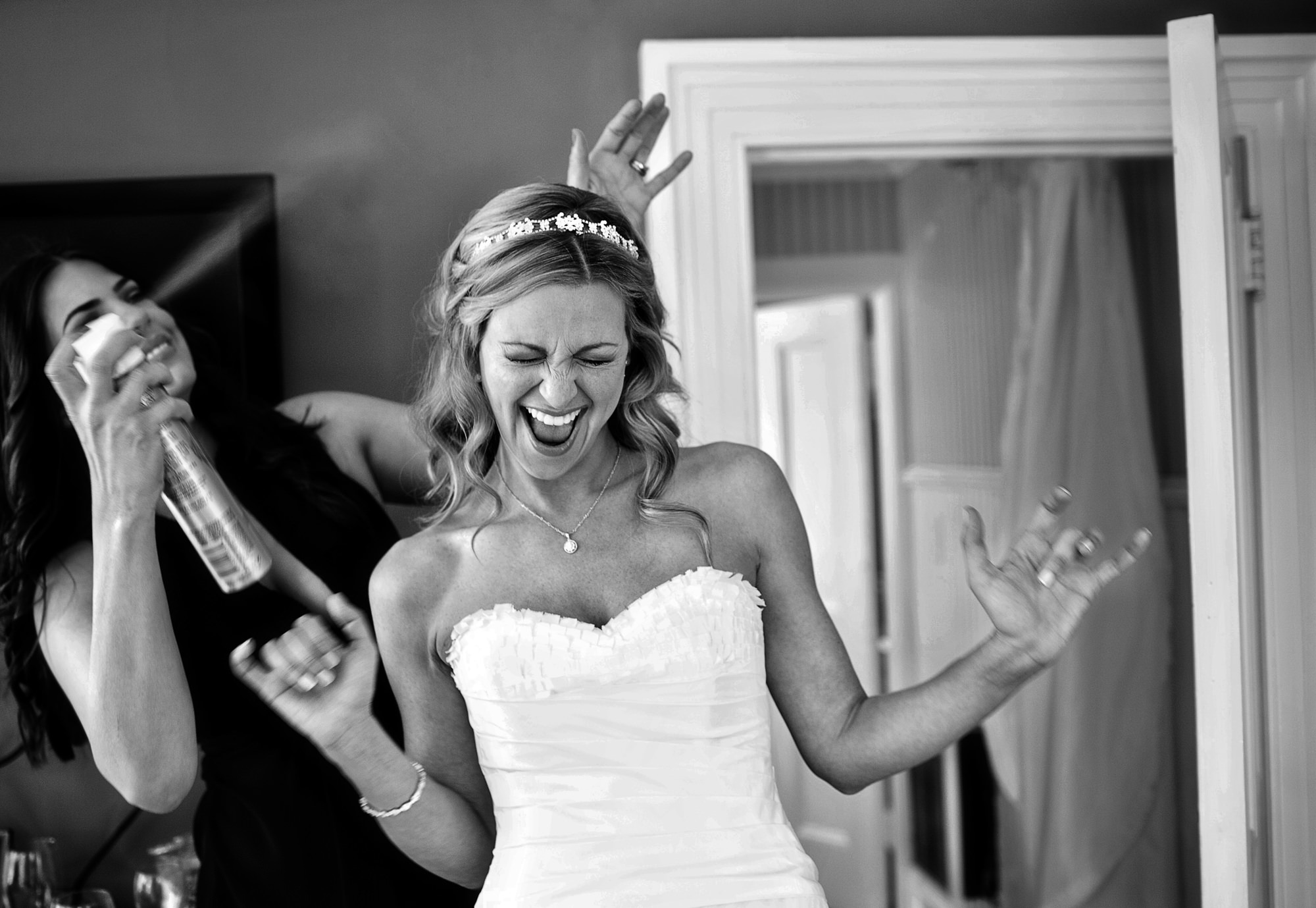 Bride getting hairspray - photo by JAG Studios
