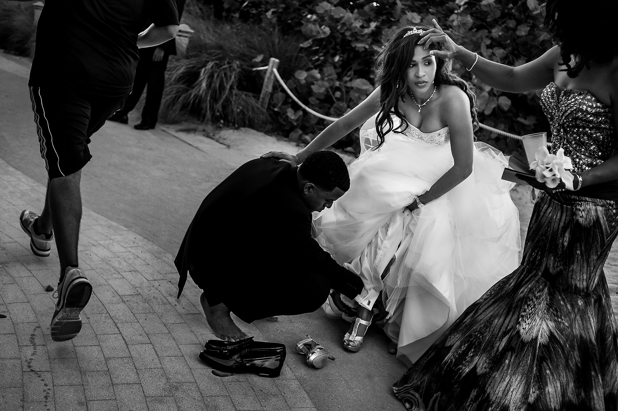 Grooming removing bride's shoes -  Davina + Daniel